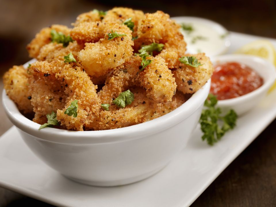 Close up of fried shrimp in a bowl.