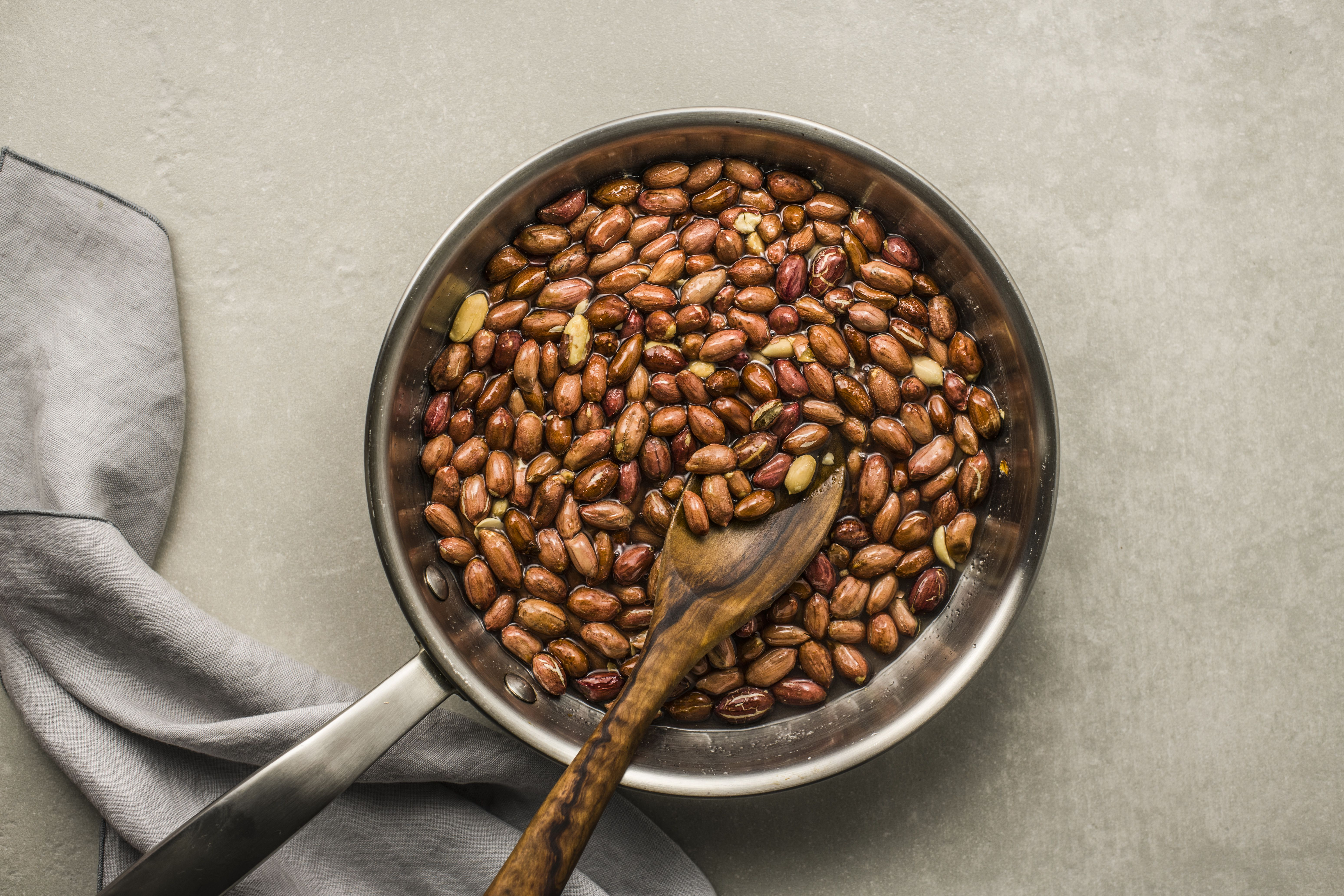 Combine peanut, sugar, and water