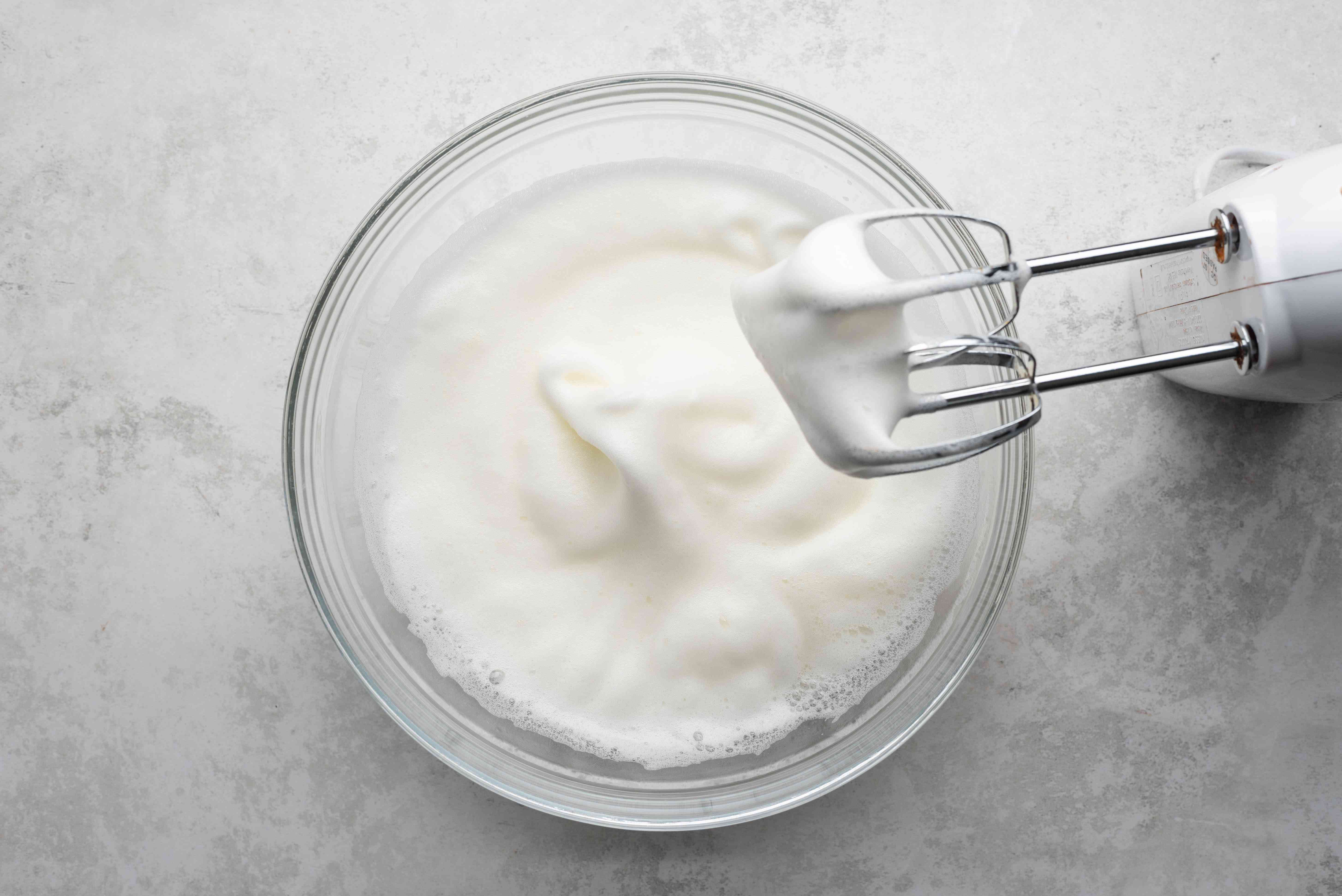 Beat egg whites in a bowl, hand mixer