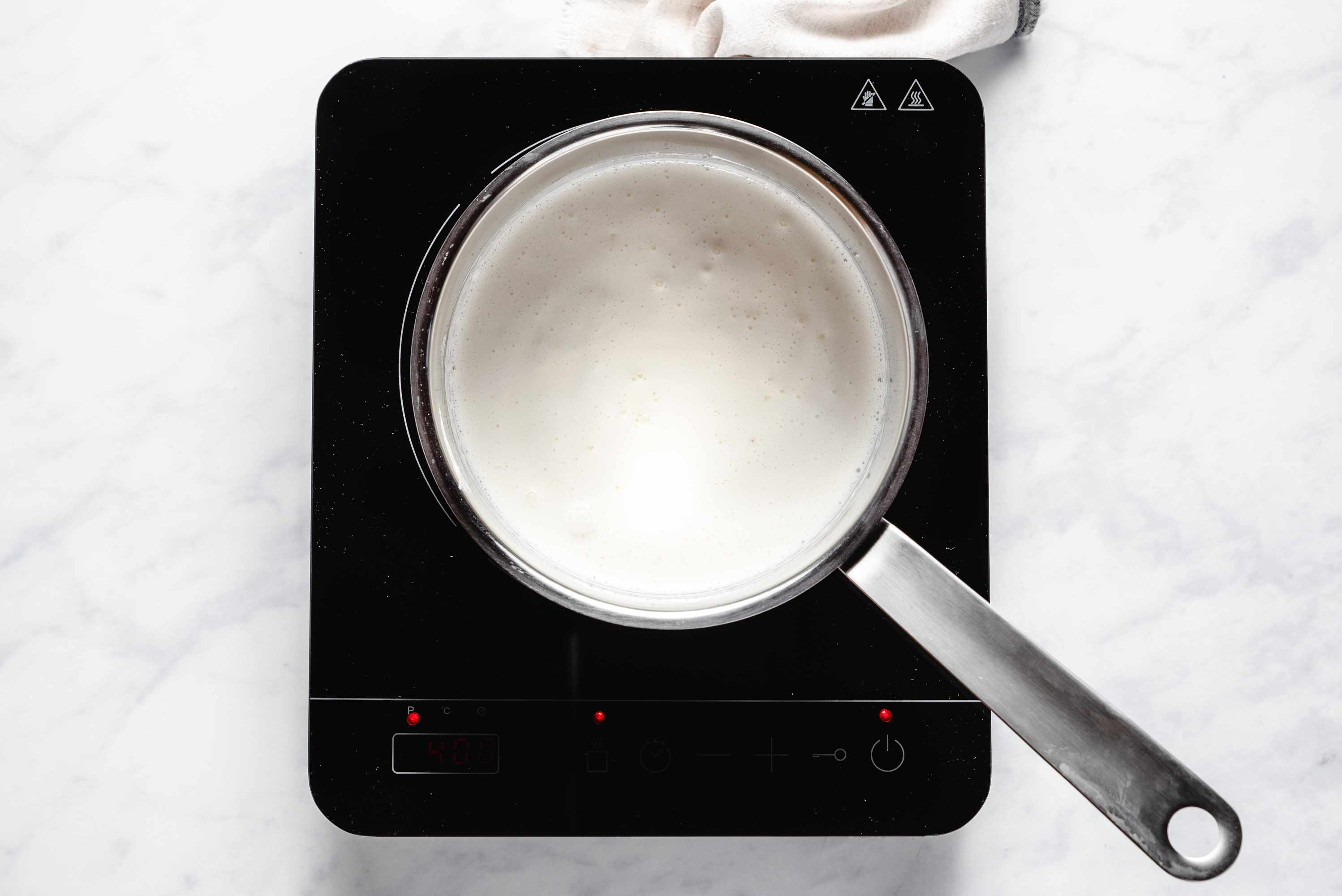heavy cream and powdered sugar in a pan