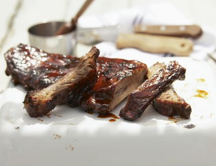Ribs cut from beef, coated in barbecue sauce, close-up