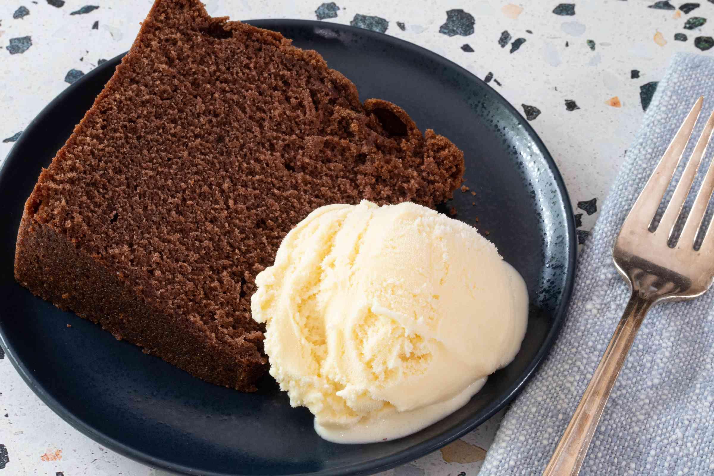 Slice of chocolate cake with vanilla ice cream.