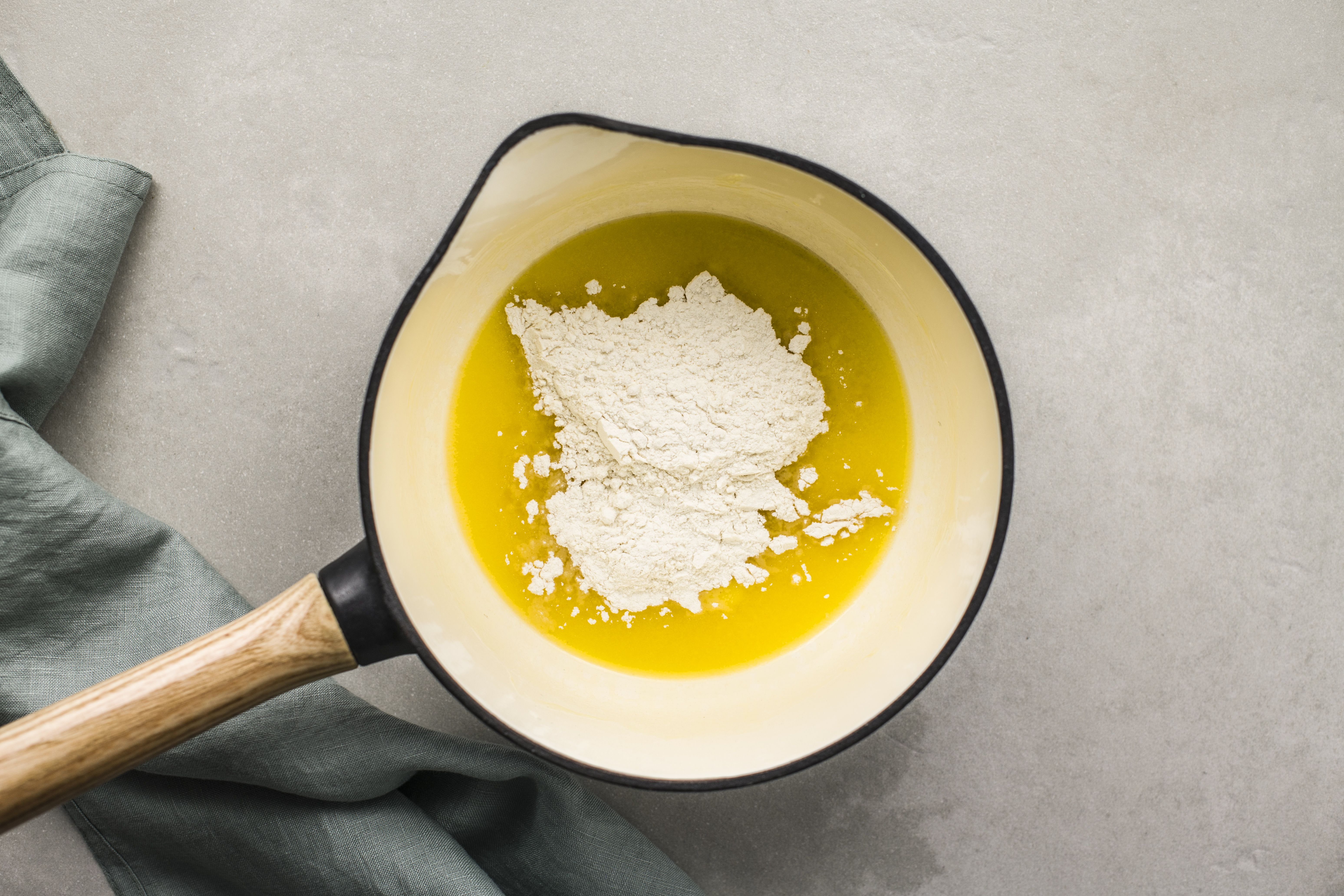 Butter melting with flour in a saucepan to make a roux