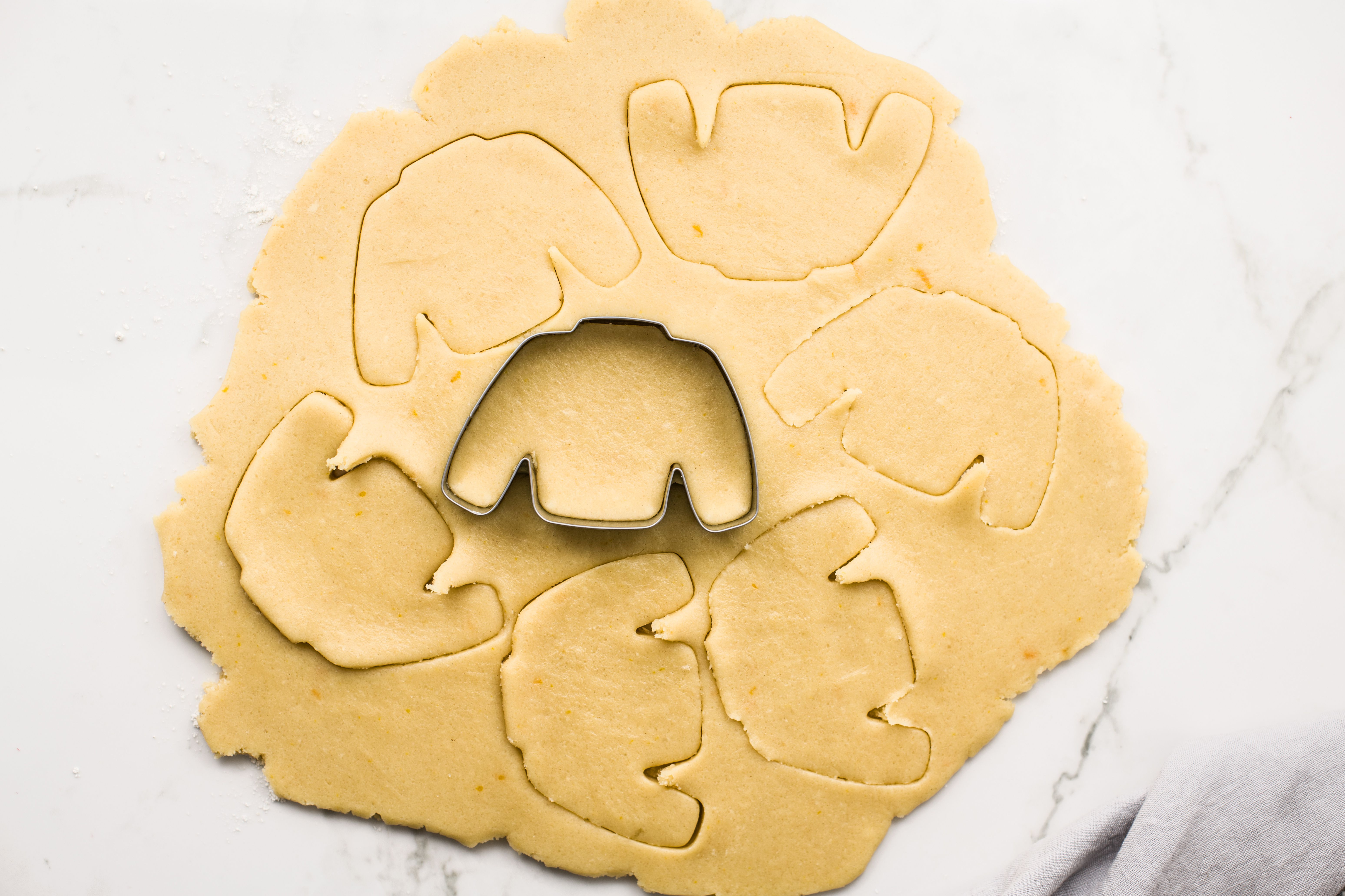 Cutting out dough into sweater shapes