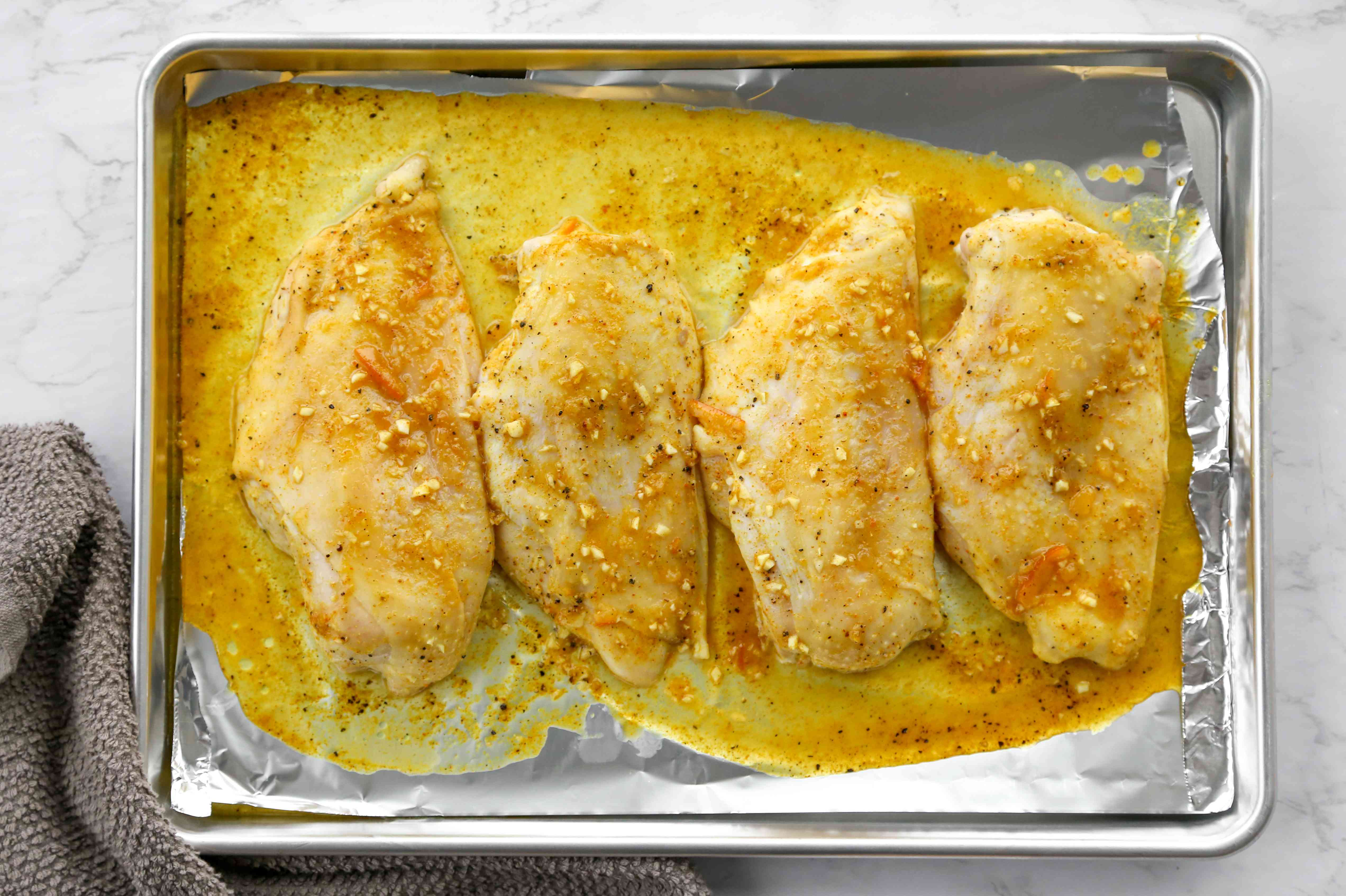 baked chicken on a baking sheet