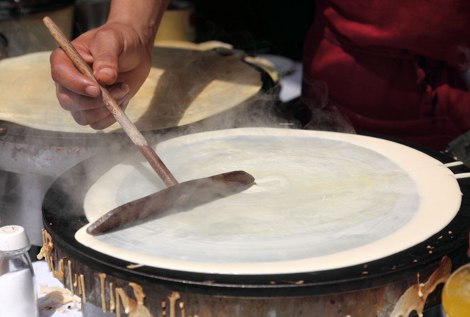 Making Crepes on a Steaming Hot Griddle
