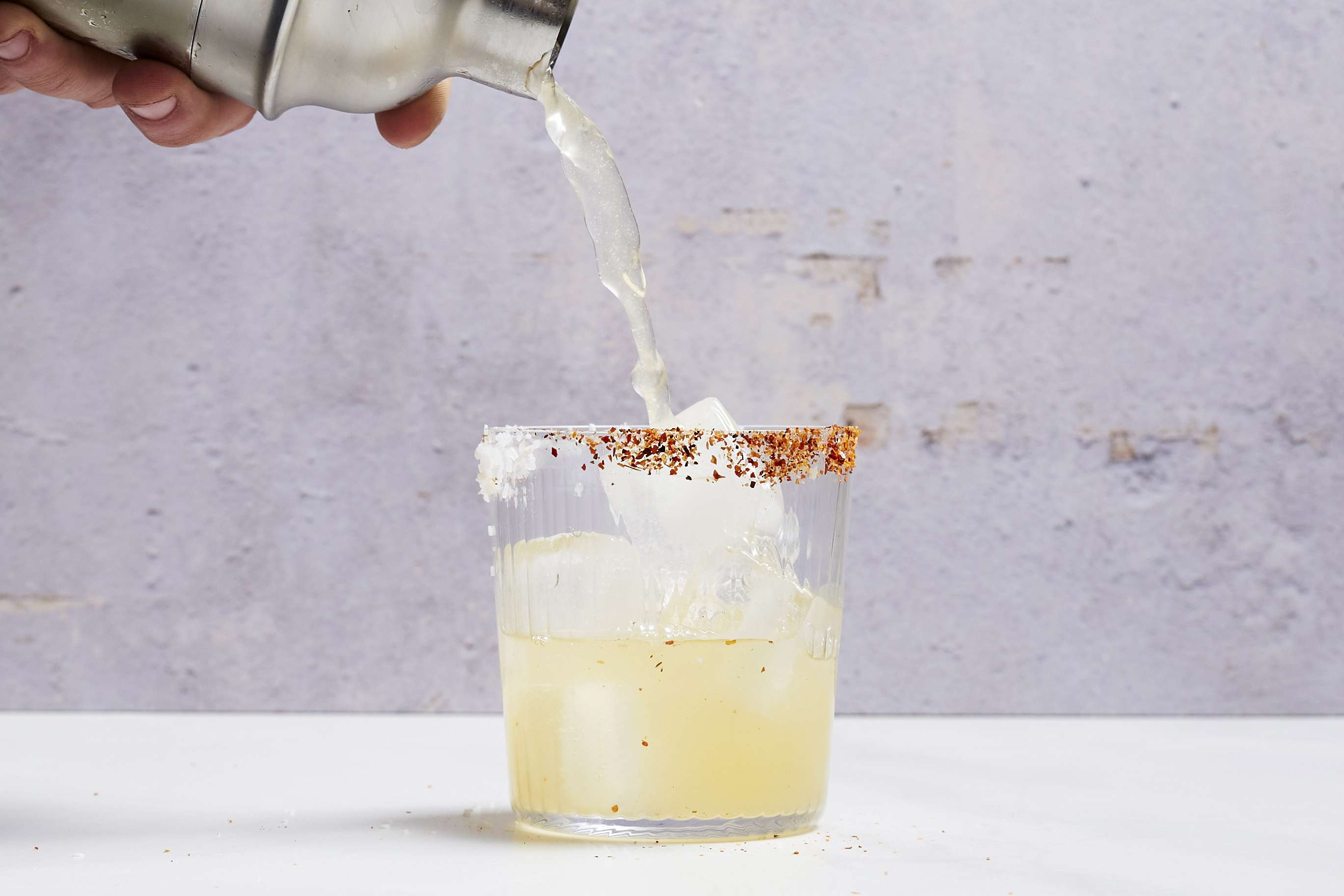 Strain cocktail into the ice-filled glass