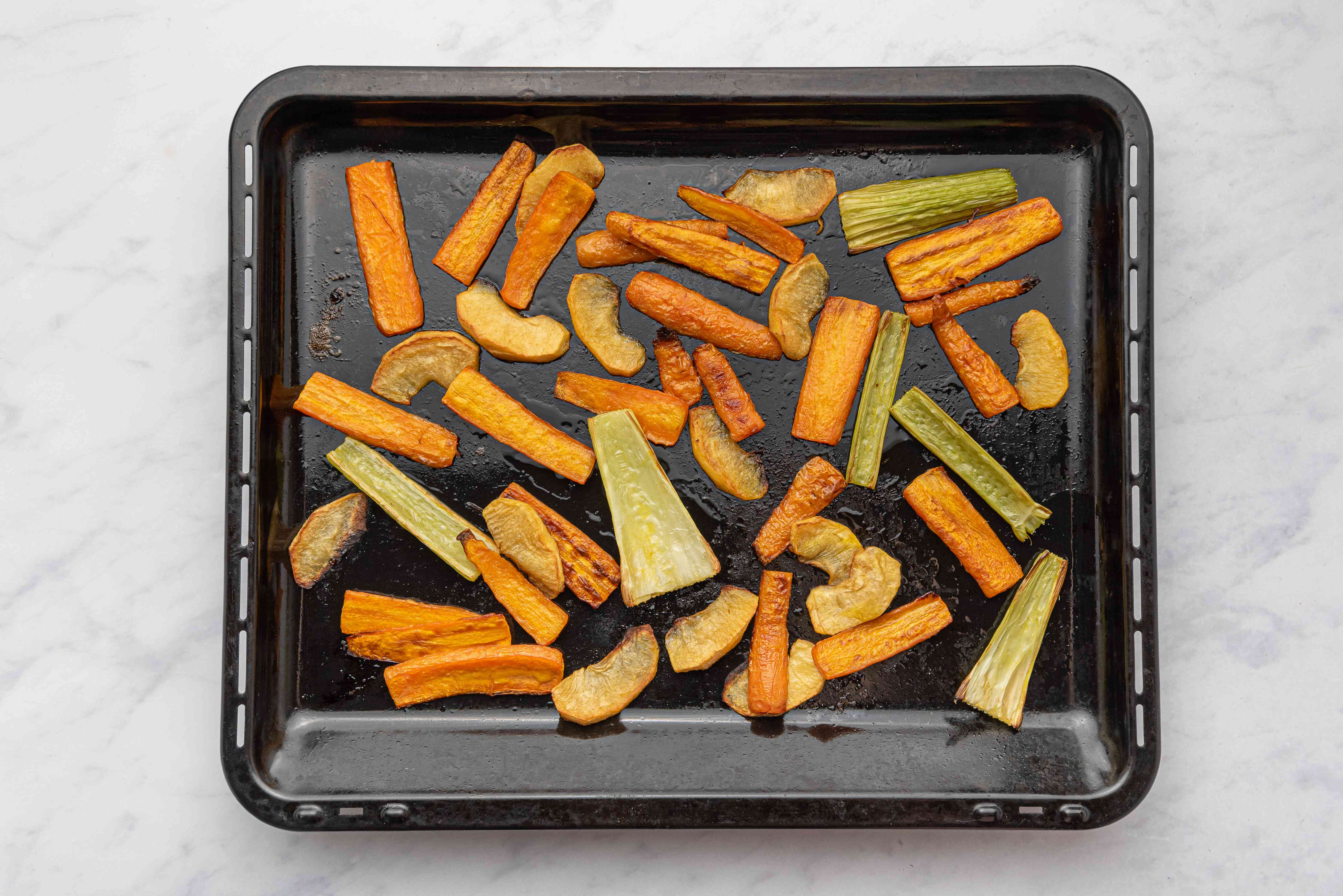 Roasted vegetables on a baking sheet