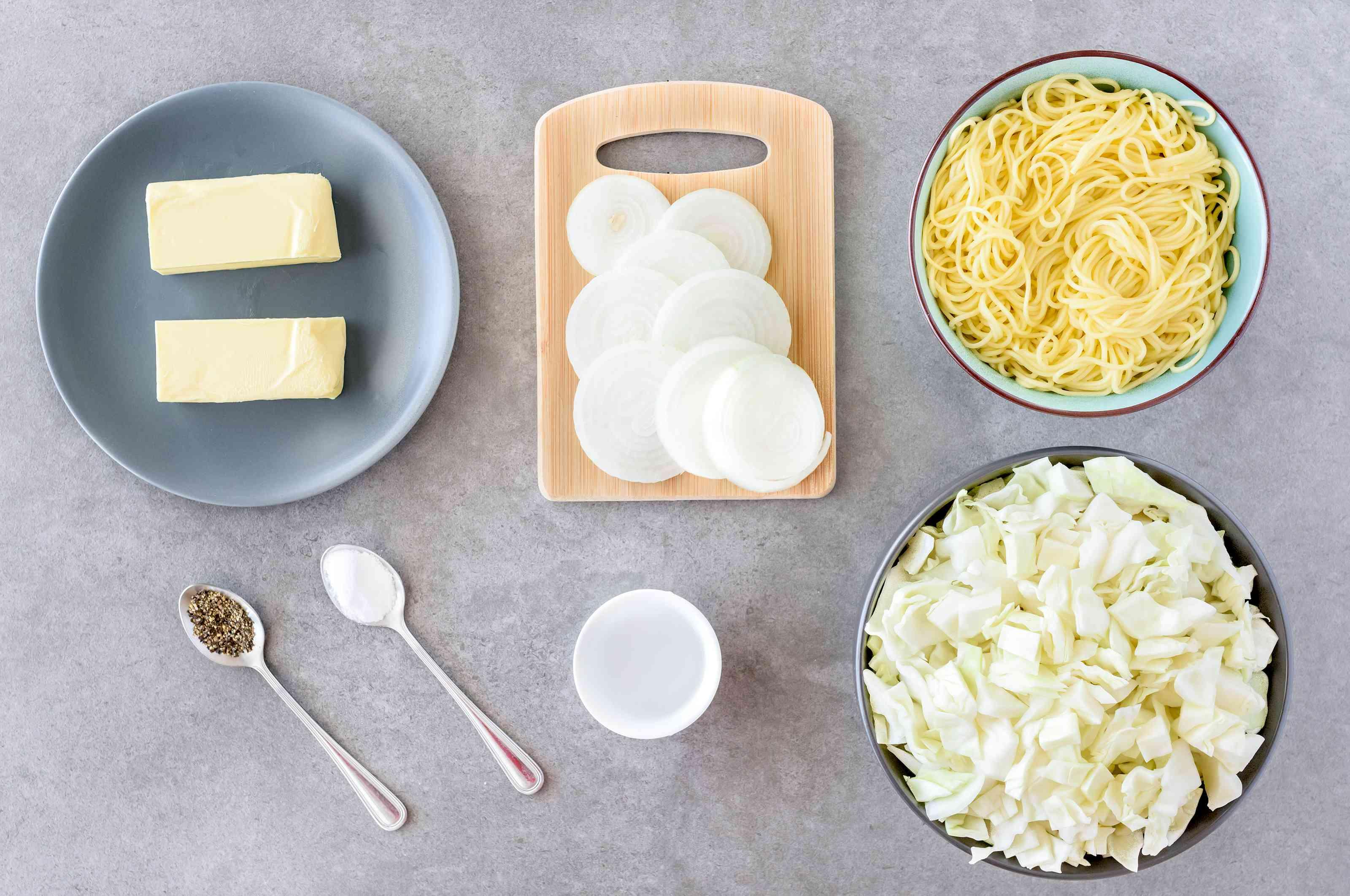 Ingredients for Polish hałuski noodles onion cabbage recipe