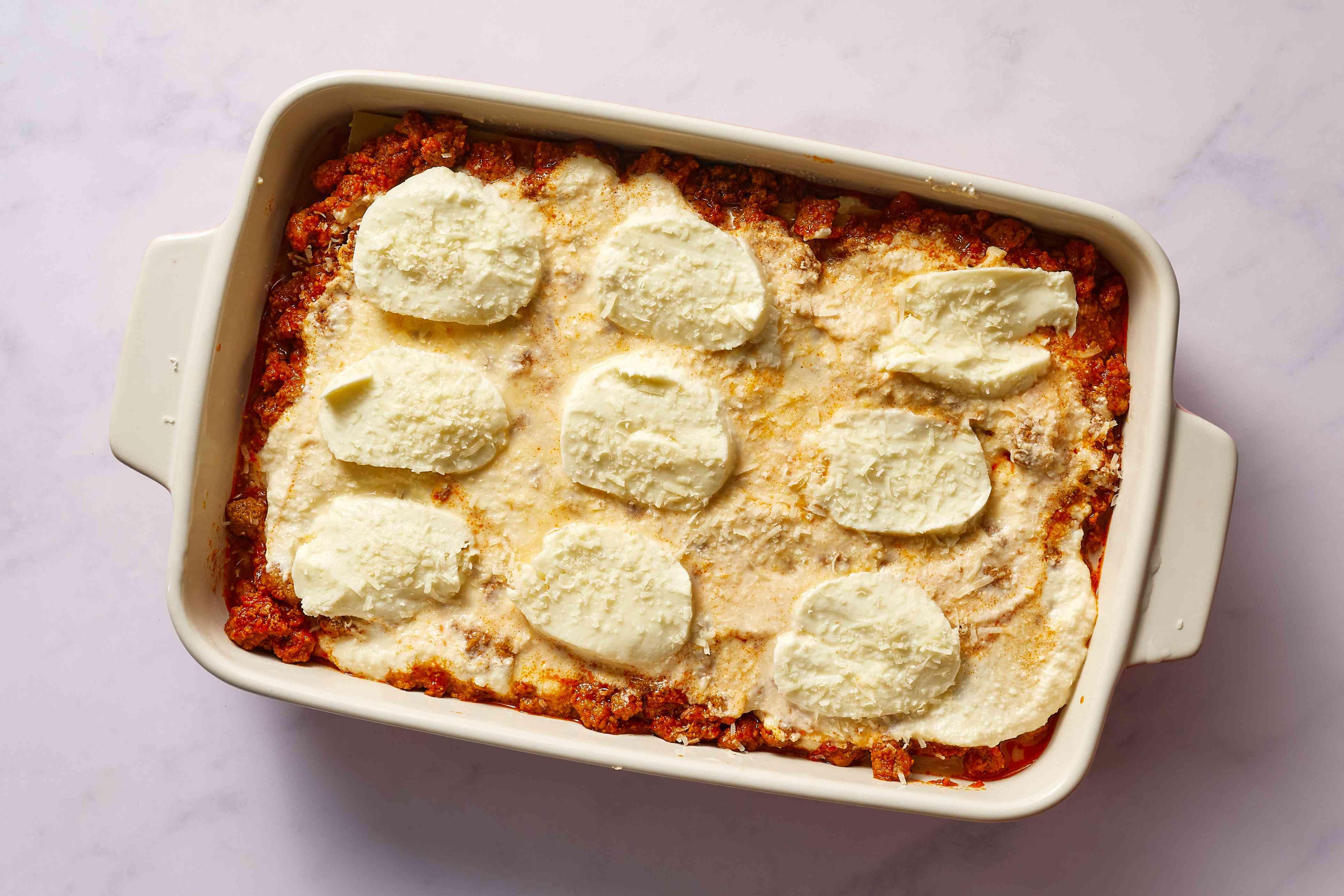 Lasagna layered in a pan before baking