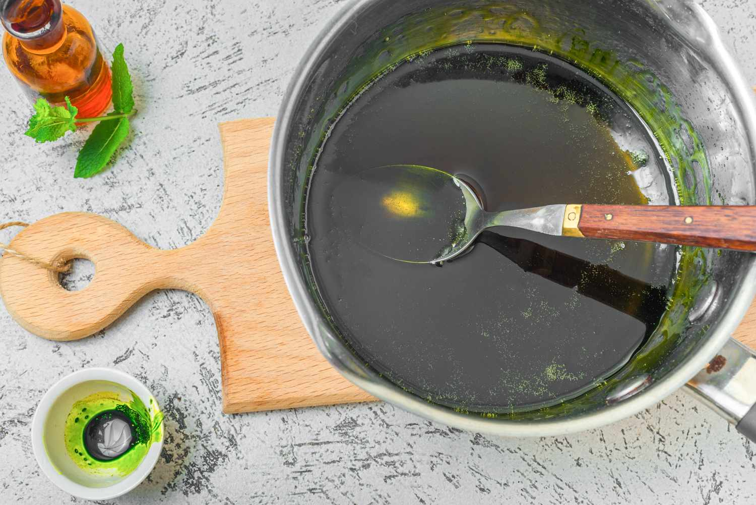 Stirring in green syrup for lollipops