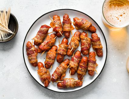 Bacon wrapped sausages appetizer on a plate