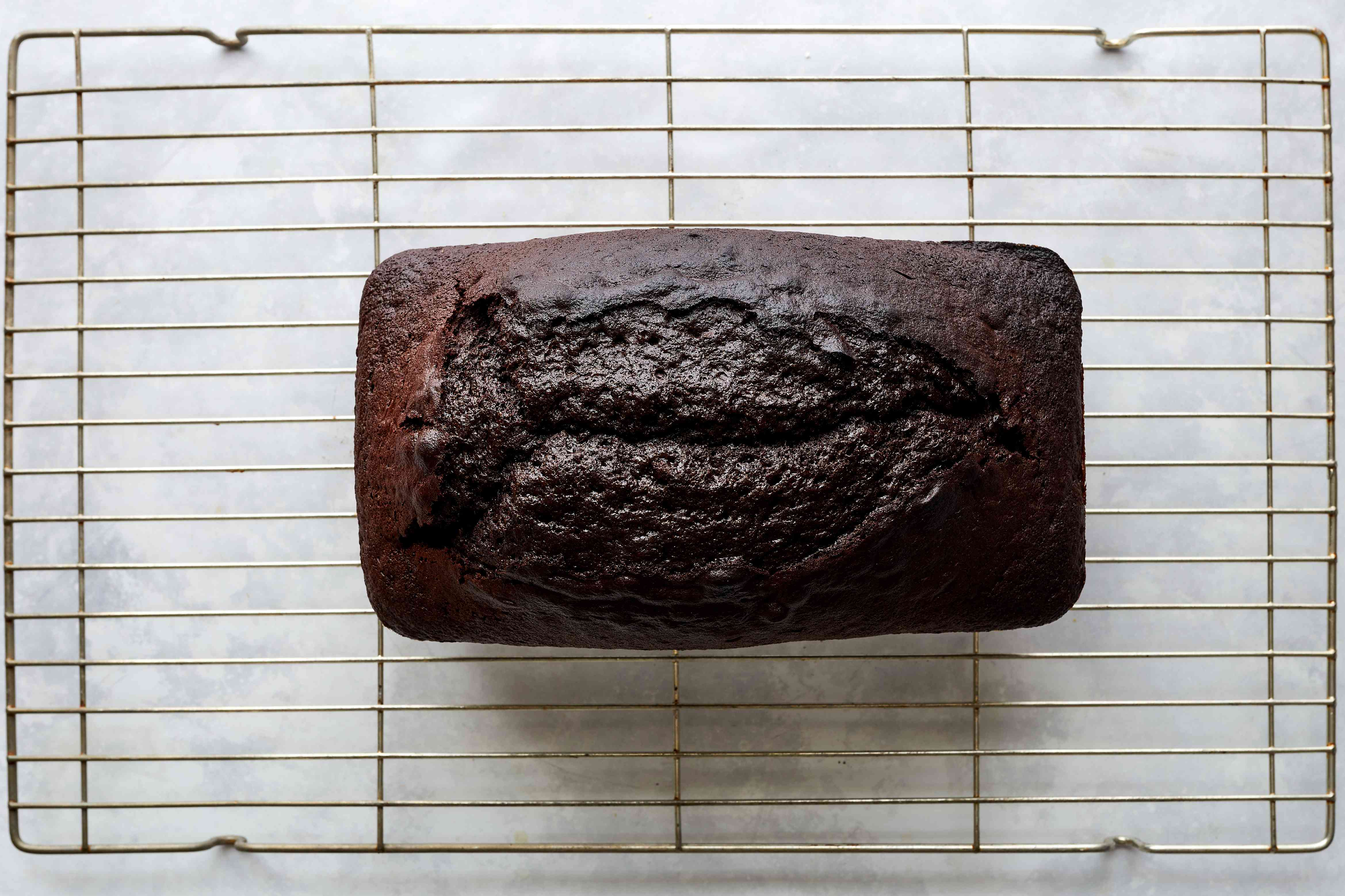 chocolate loaf cake on a metal cooling rack