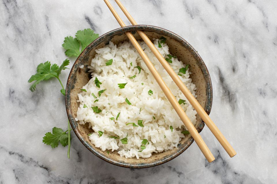rice with cilantro and chopsticks