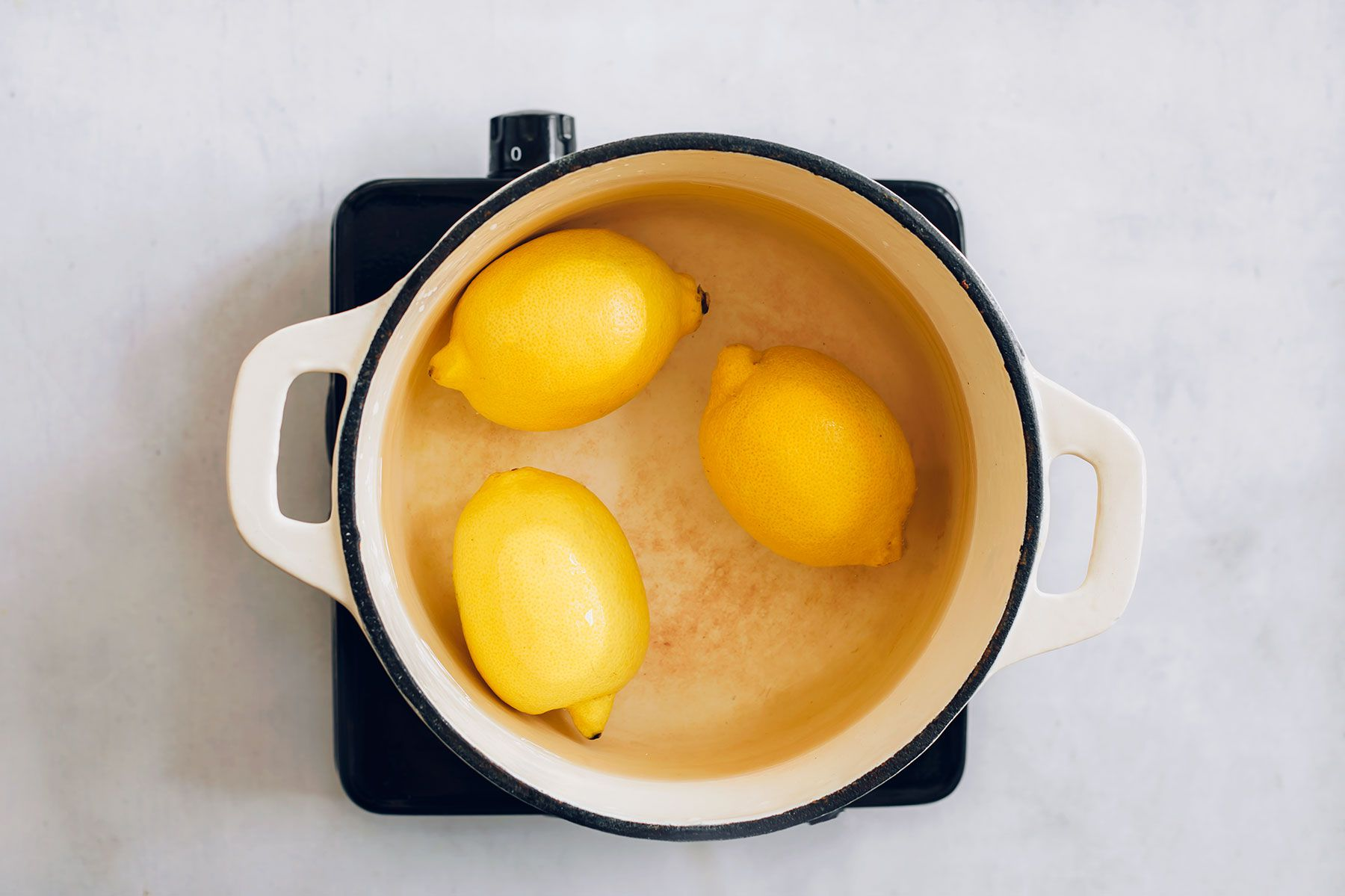 Lemons cooking in a pot of water
