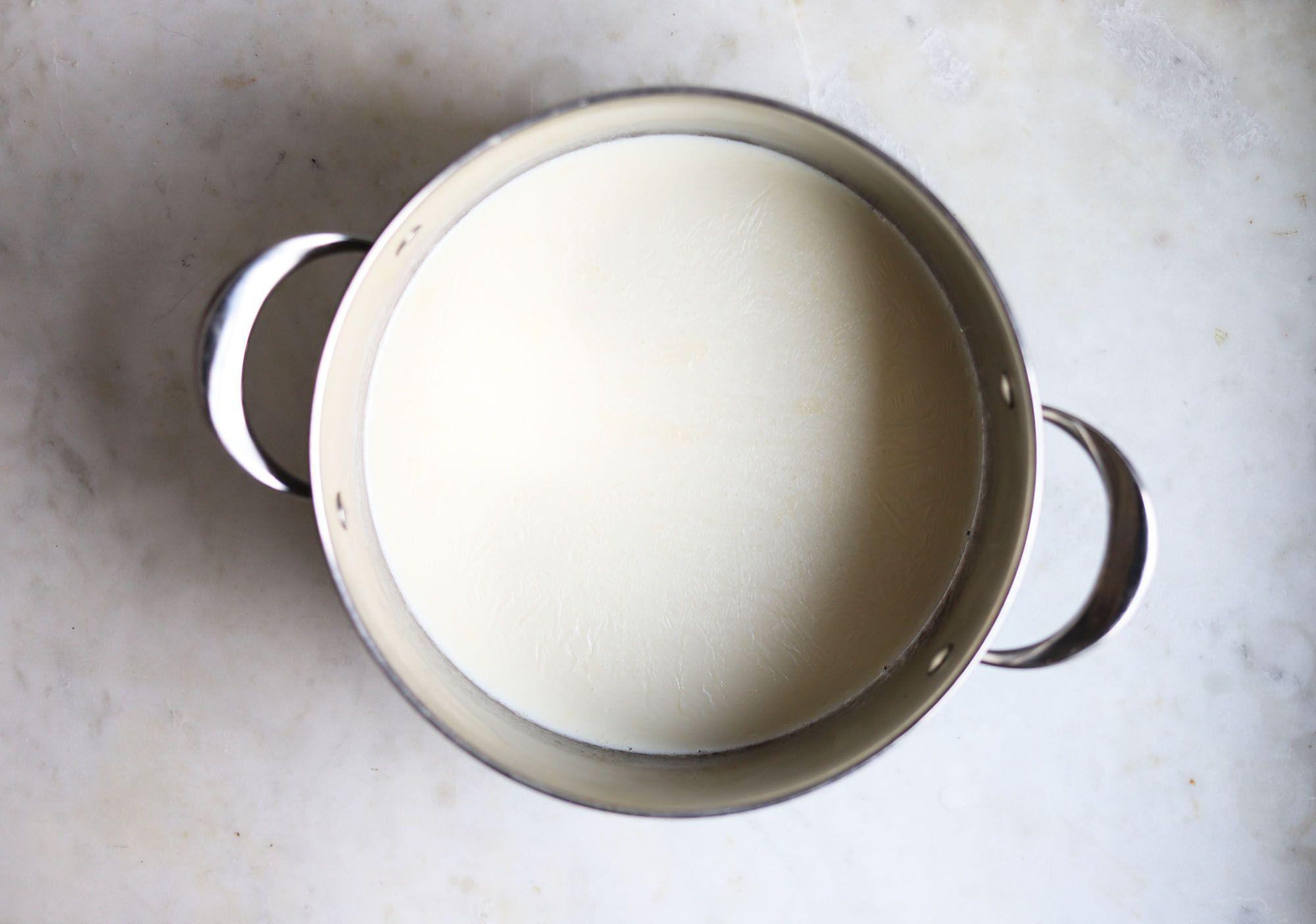 milk heating in a saucepan