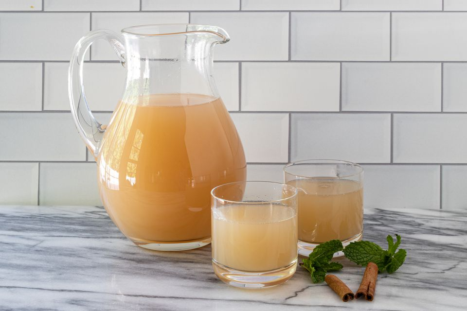 apple juice in glasses and a pitcher