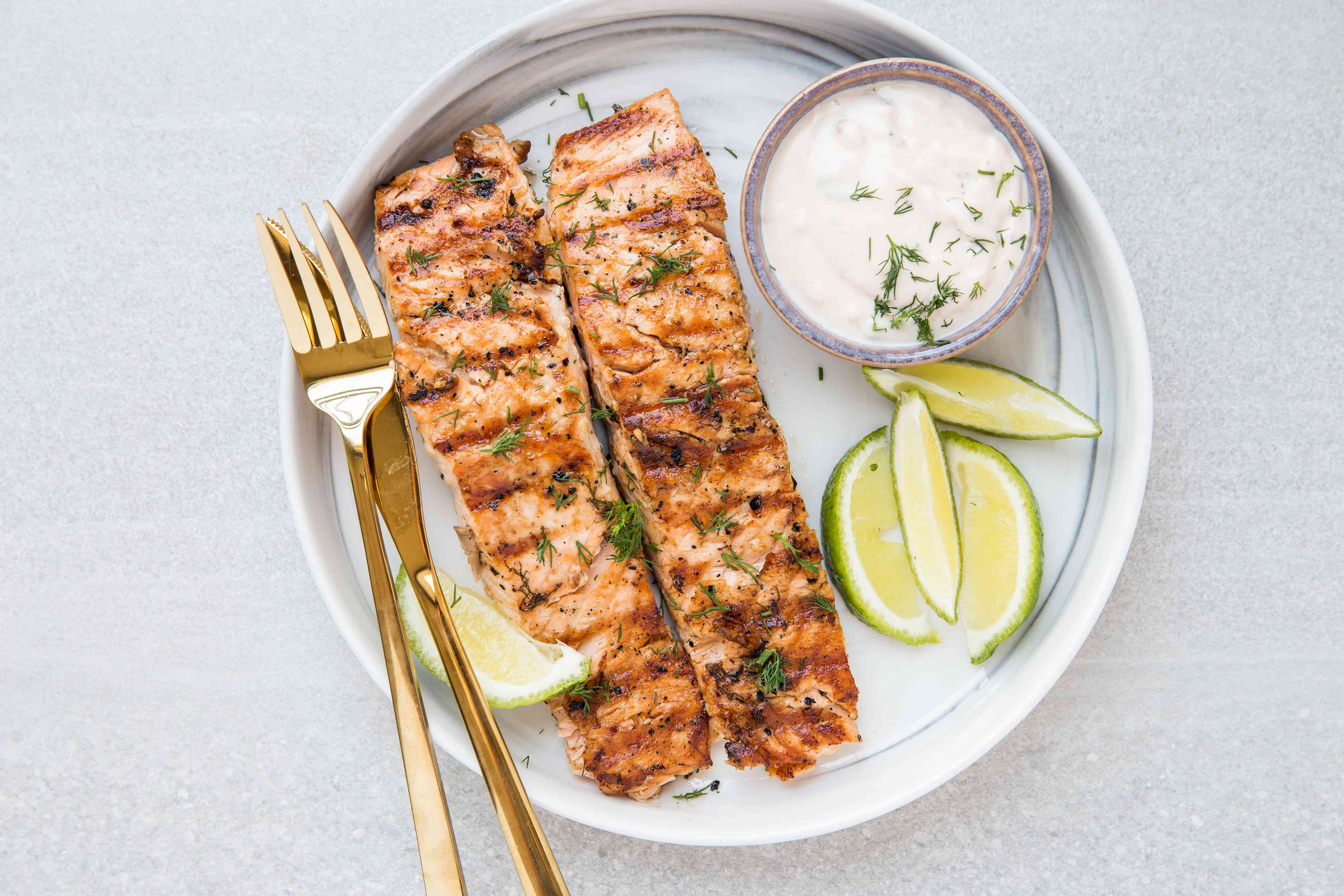 Mayonnaise Grilled Salmon served with sauce and limes