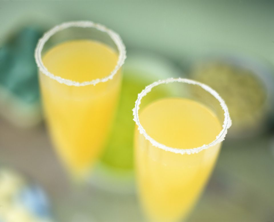 Sugar-rimmed glasses of mimosa