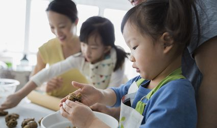 Family with toddler baking