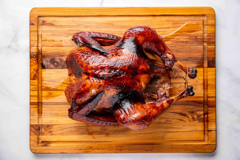 smoked turkey on a wood board