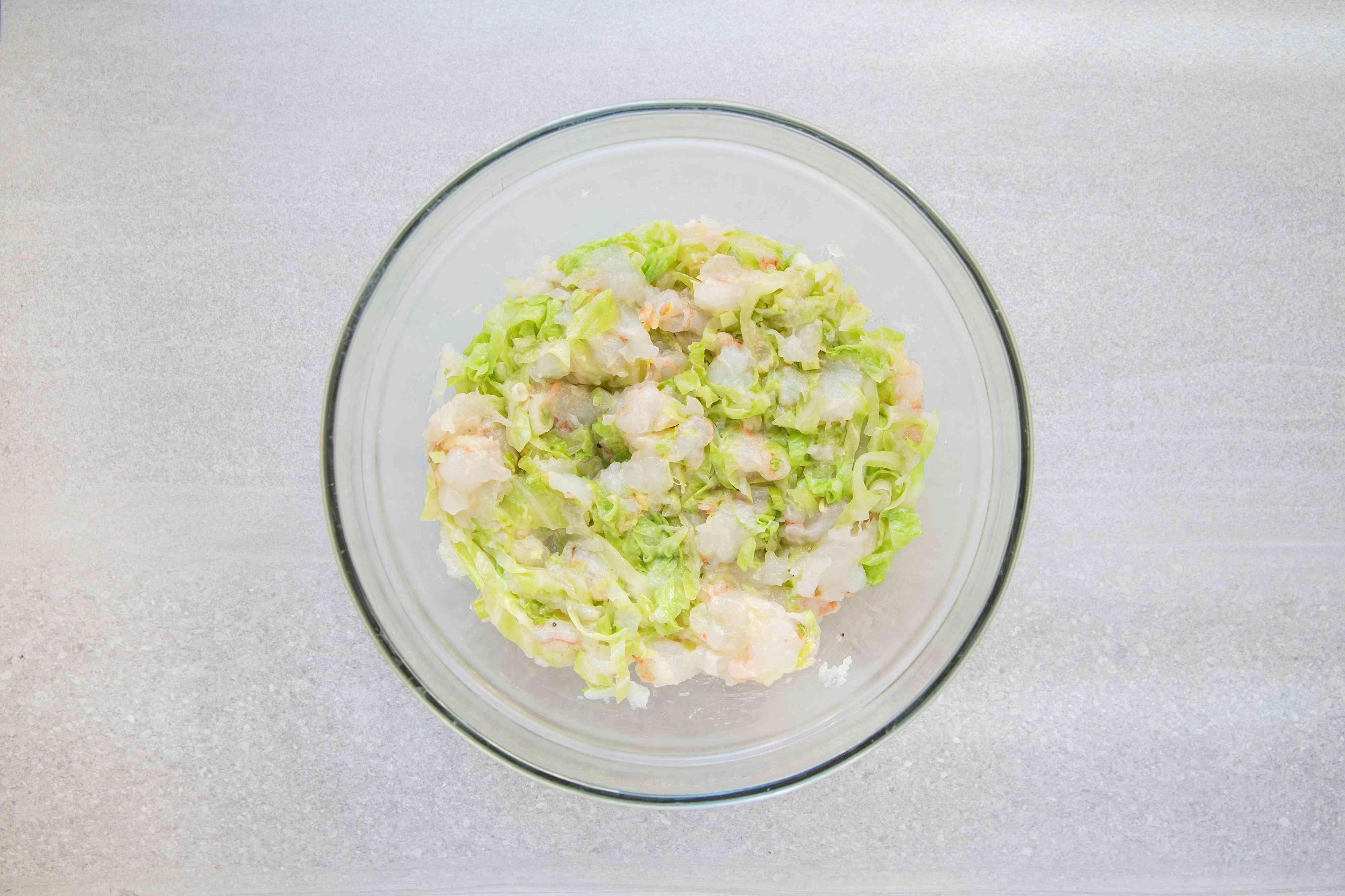 Add sake, salt, sesame oil, and katakuriko to the shrimp and cabbage mixture