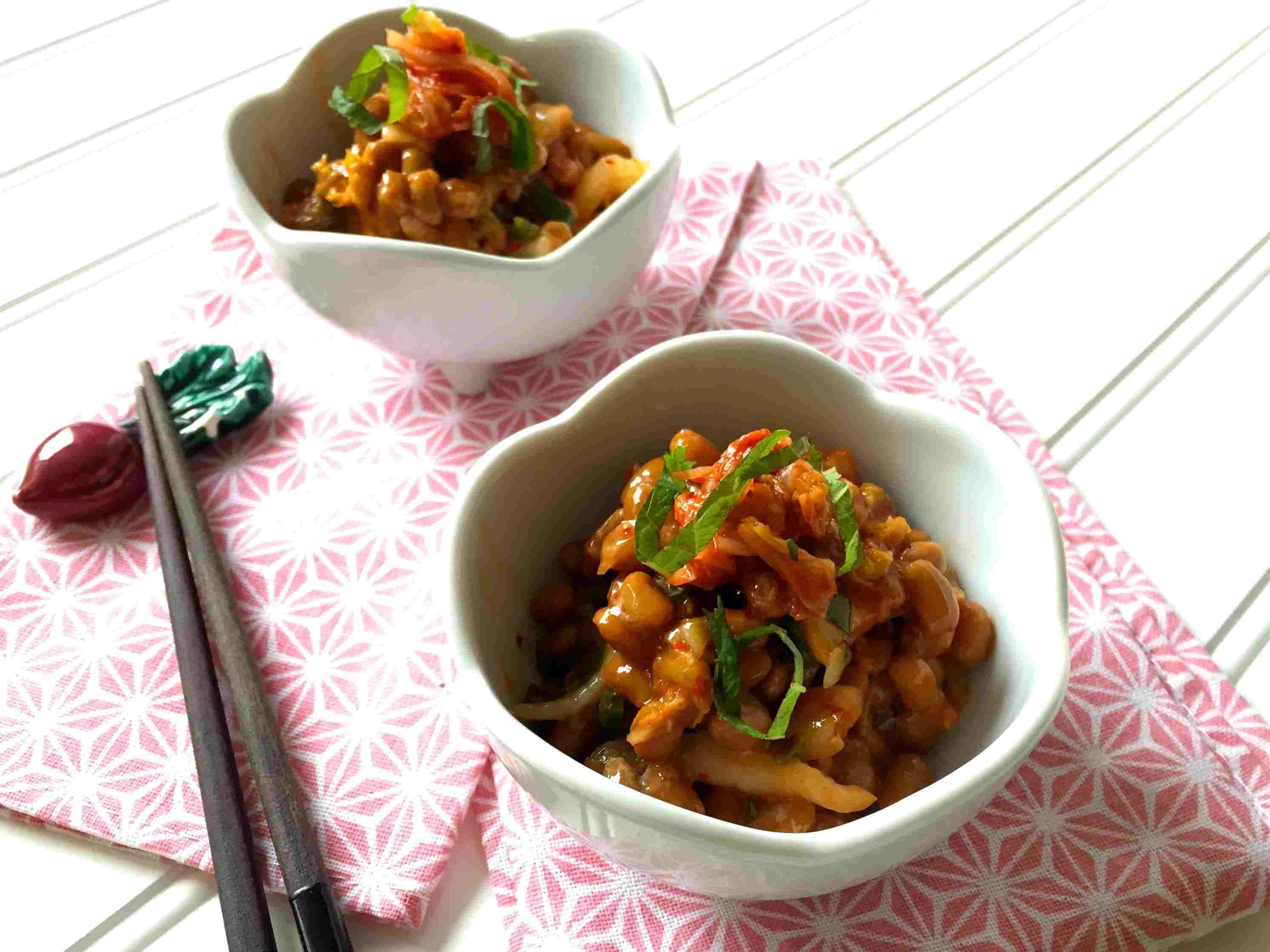 Kimchi (spicy cabbage pickles) with natto (fermented soy beans) and green perilla leaf