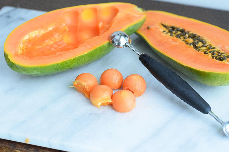 Scoop papaya out