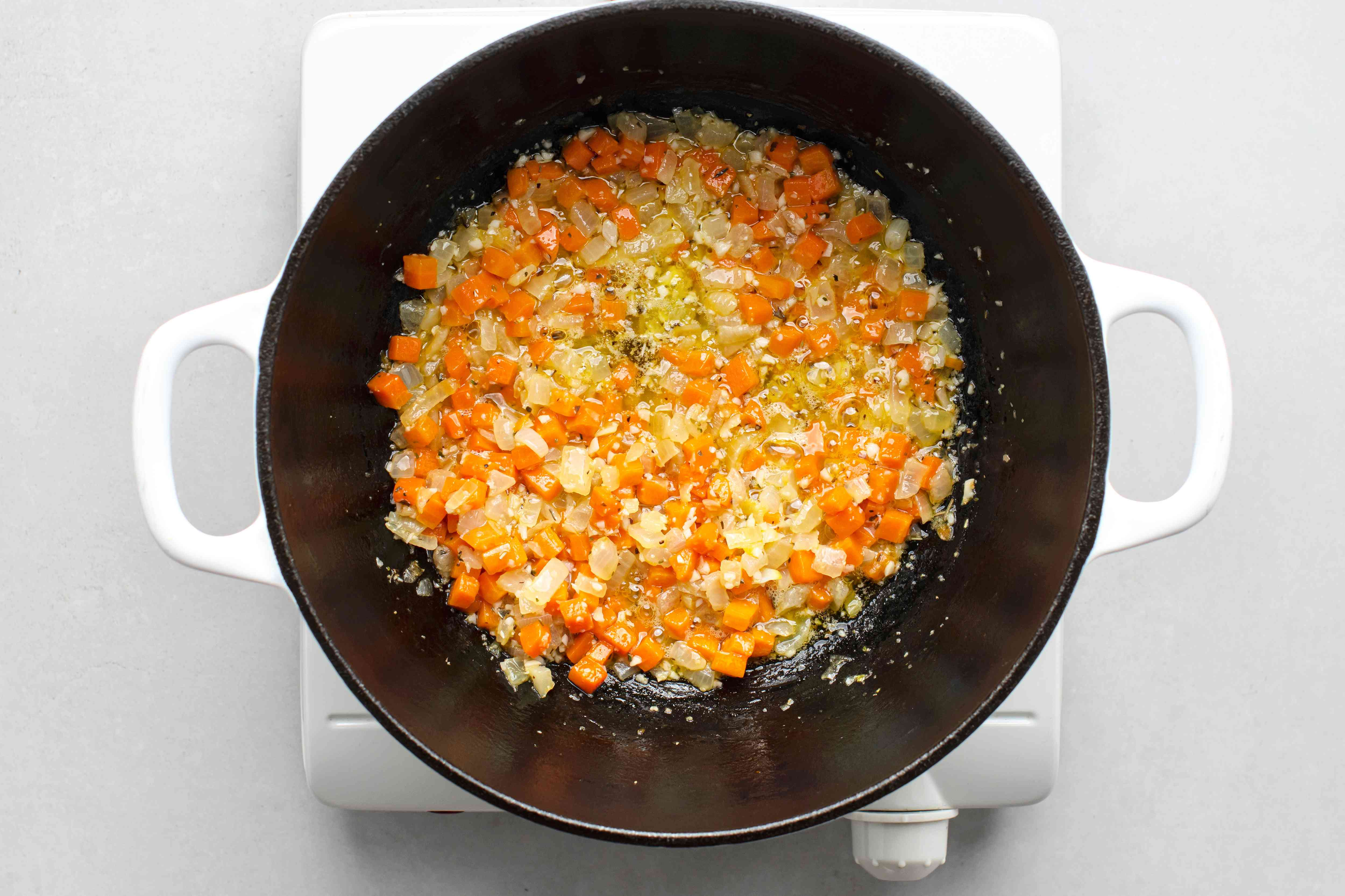 Add the garlic, lemon juice, and herb seasoning to the vegetable mixture in the Dutch oven