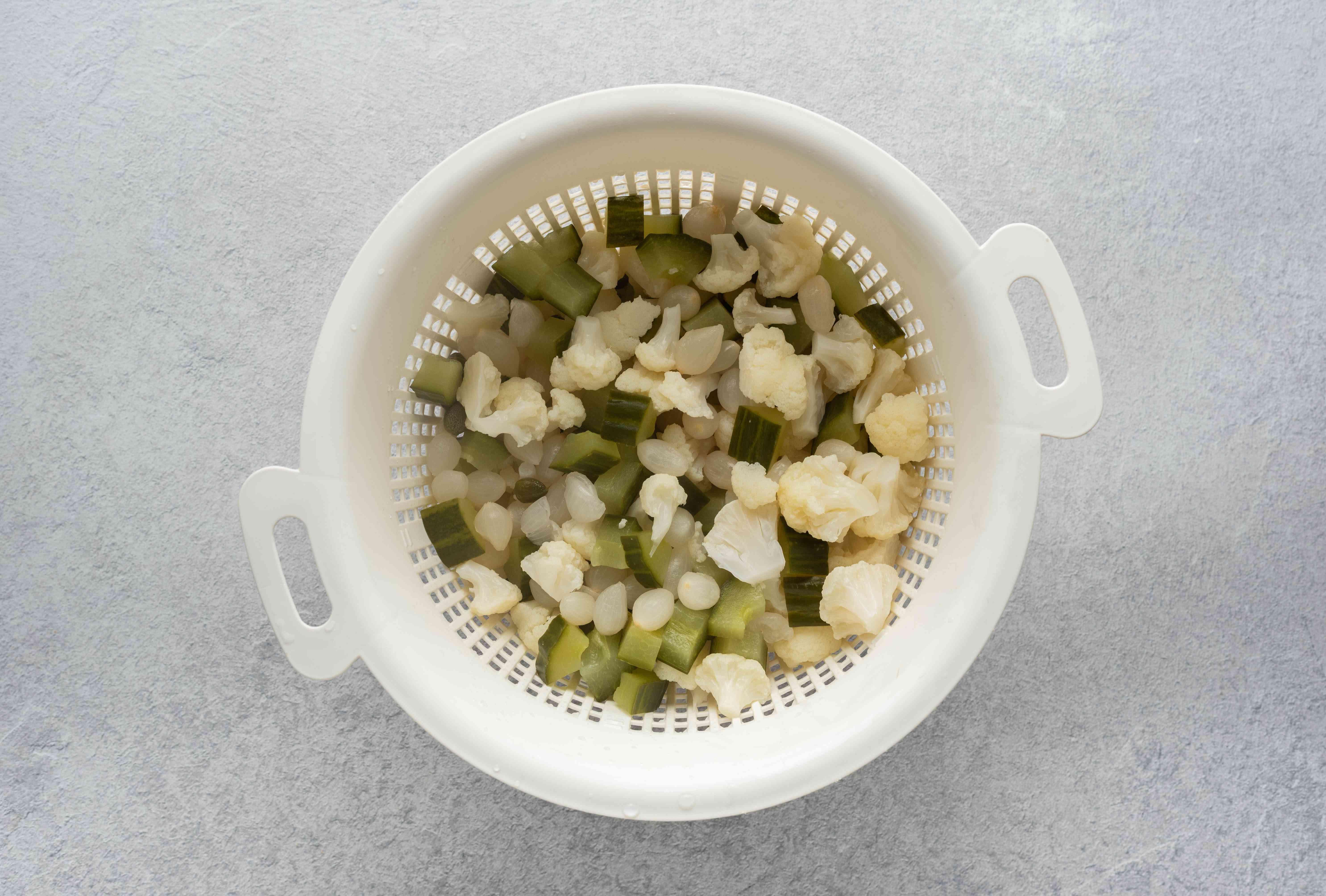 Cooked vegetables in a colander