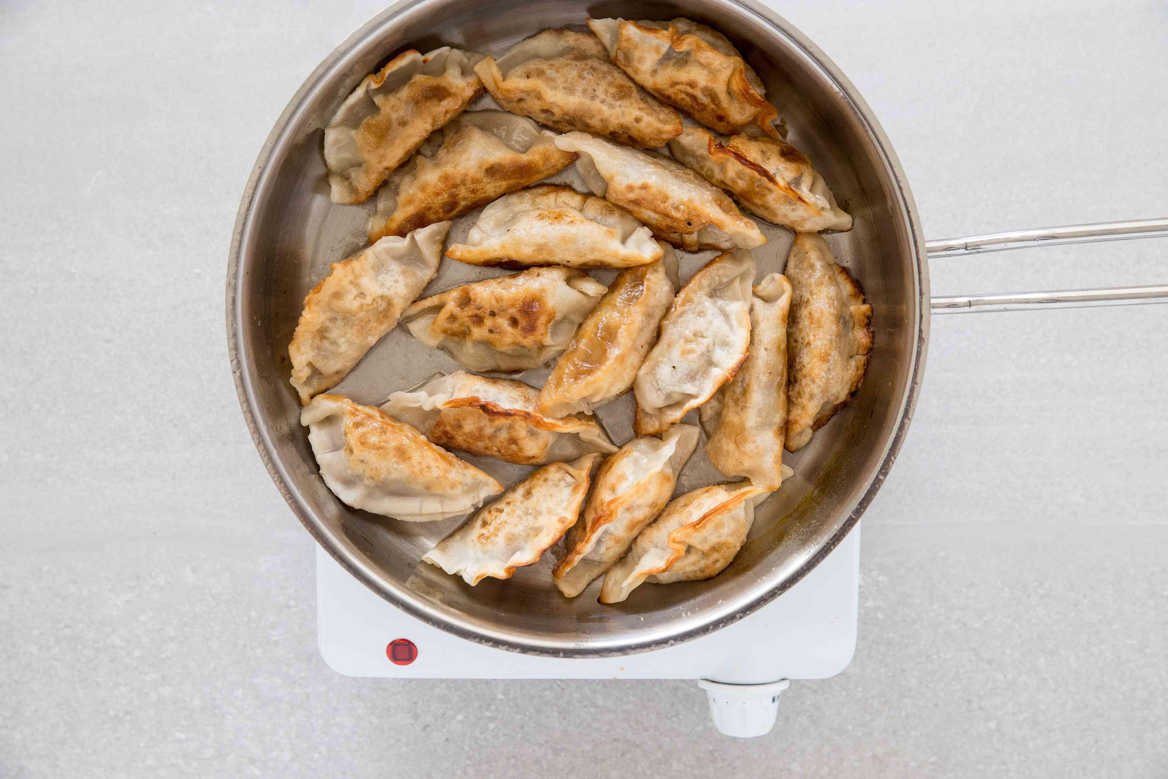 fried dumplings in a pan