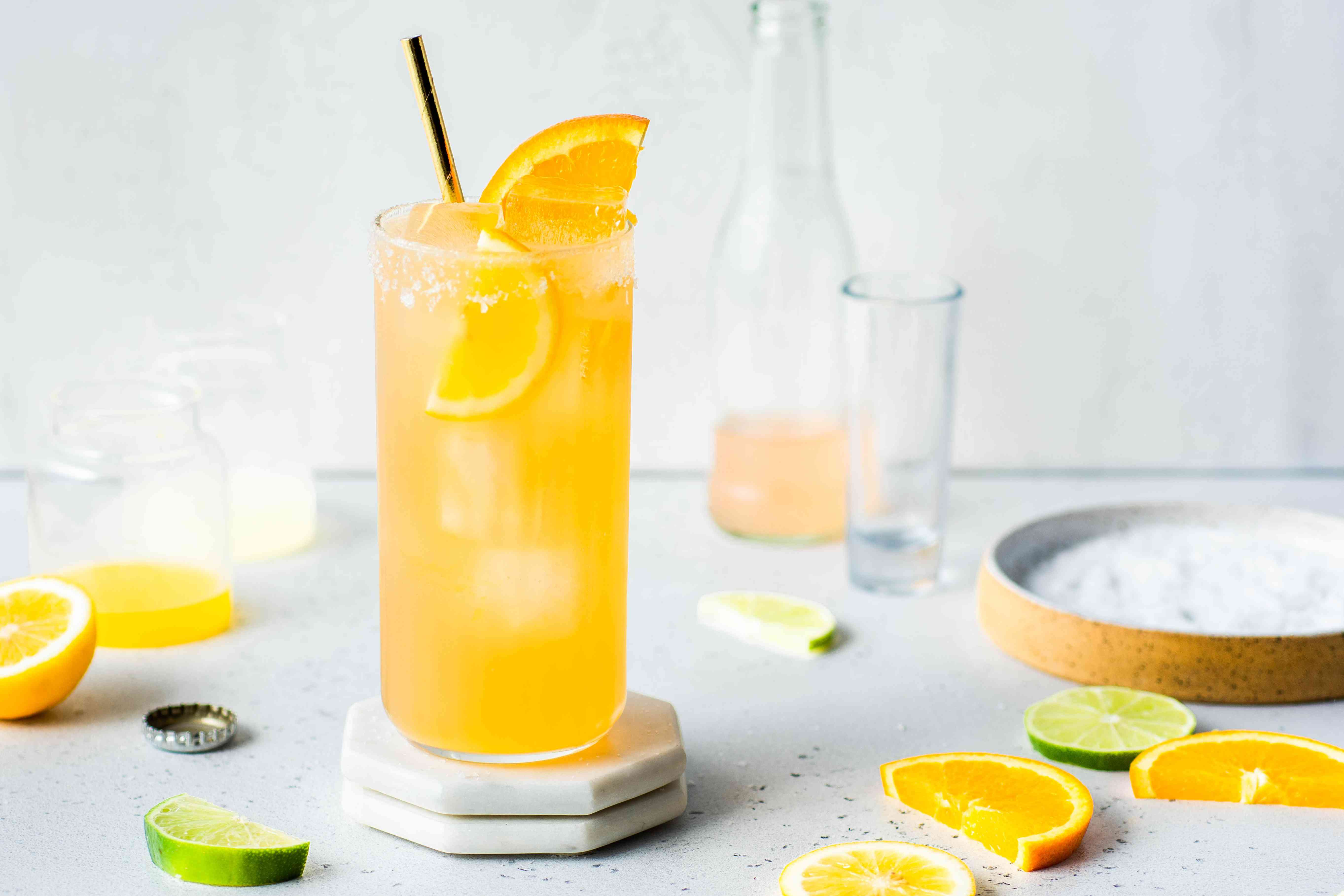 Cantarito Tequila Cocktail recipe, cocktail in a glass with orange and lime slices