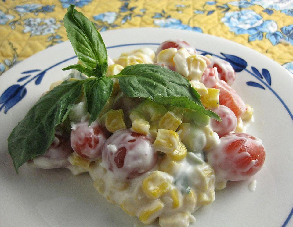 Fresh Corn Salad garnished with basil