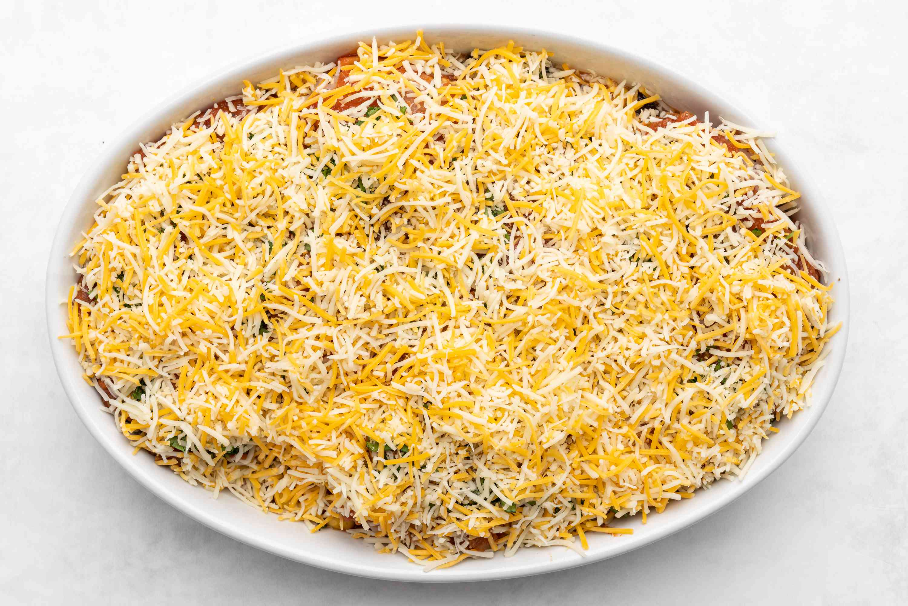Arrange chicken over bean and corn mixture, add cheese on top