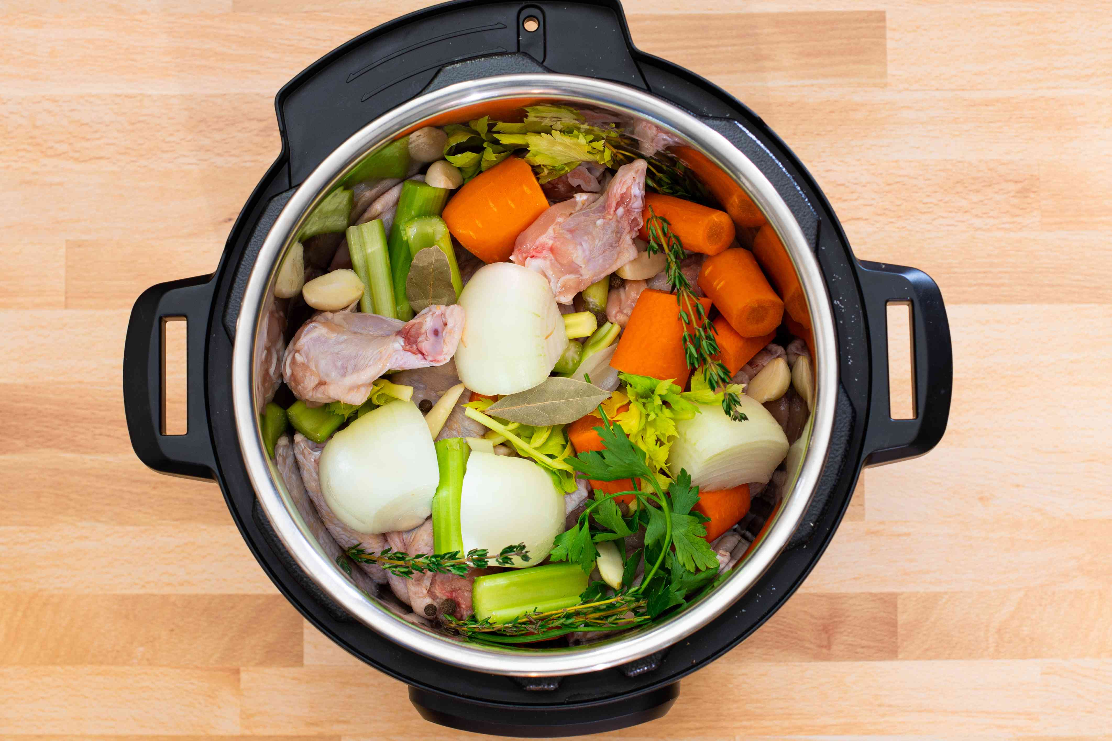 instant pot with vegetables and chicken for stock