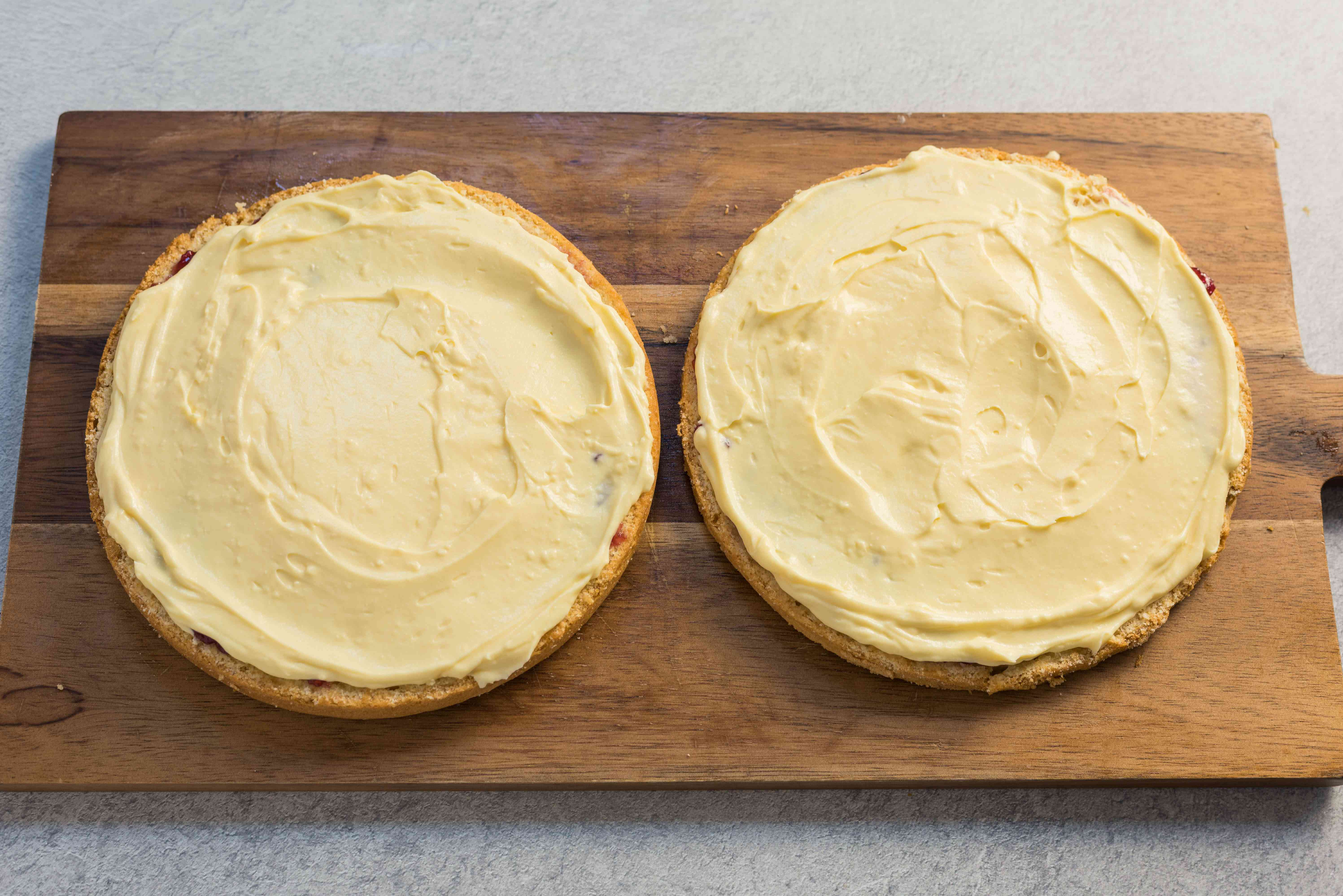 Spread pastry cream on top of cake