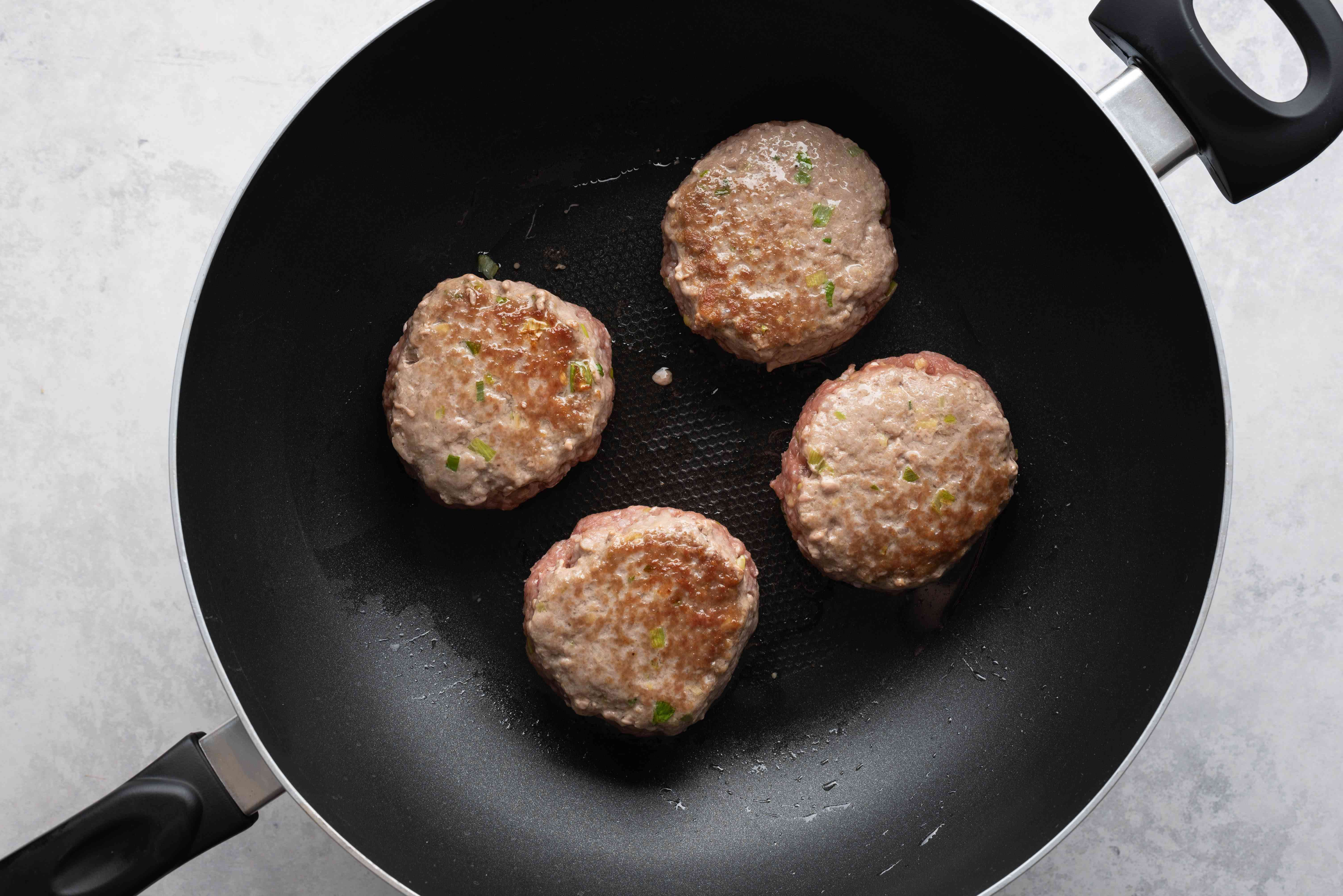 meatballs cooking in a wok