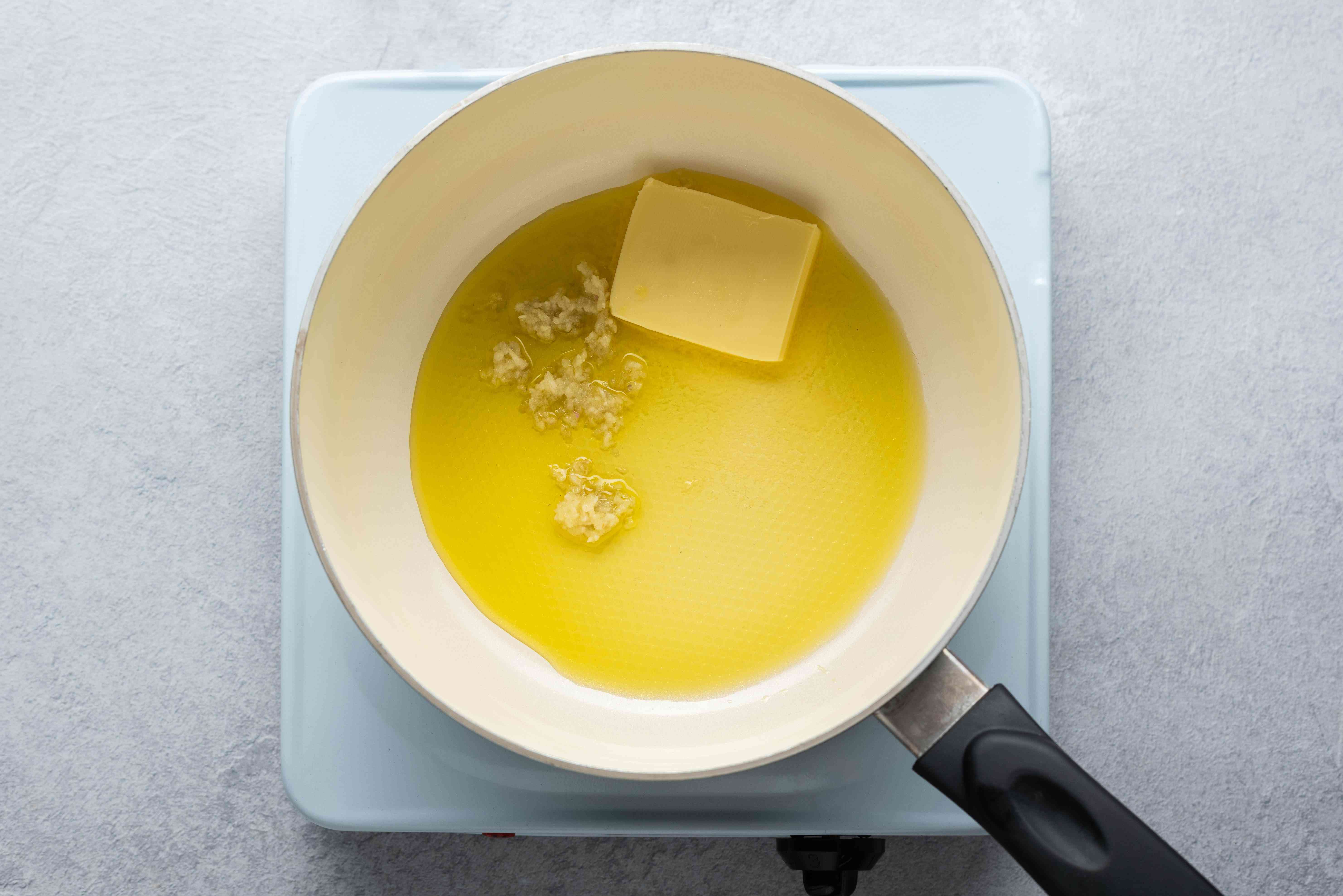 combine the butter, oil, and garlic in a pot