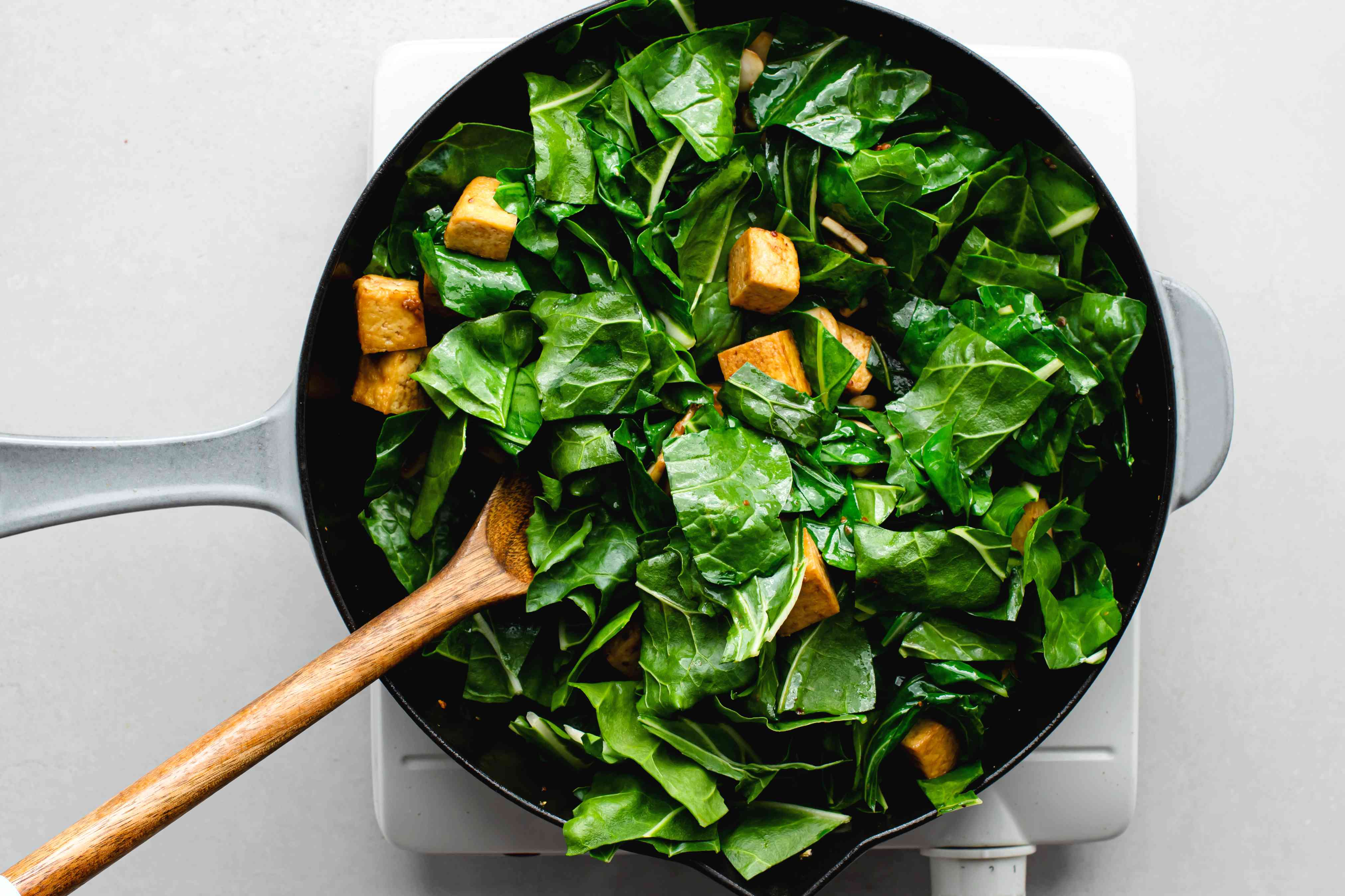 Swiss Chard in a skillet with tofu and mushrooms