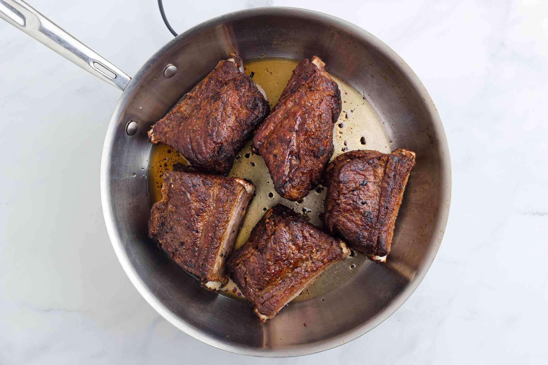 steaks cooking in a pan