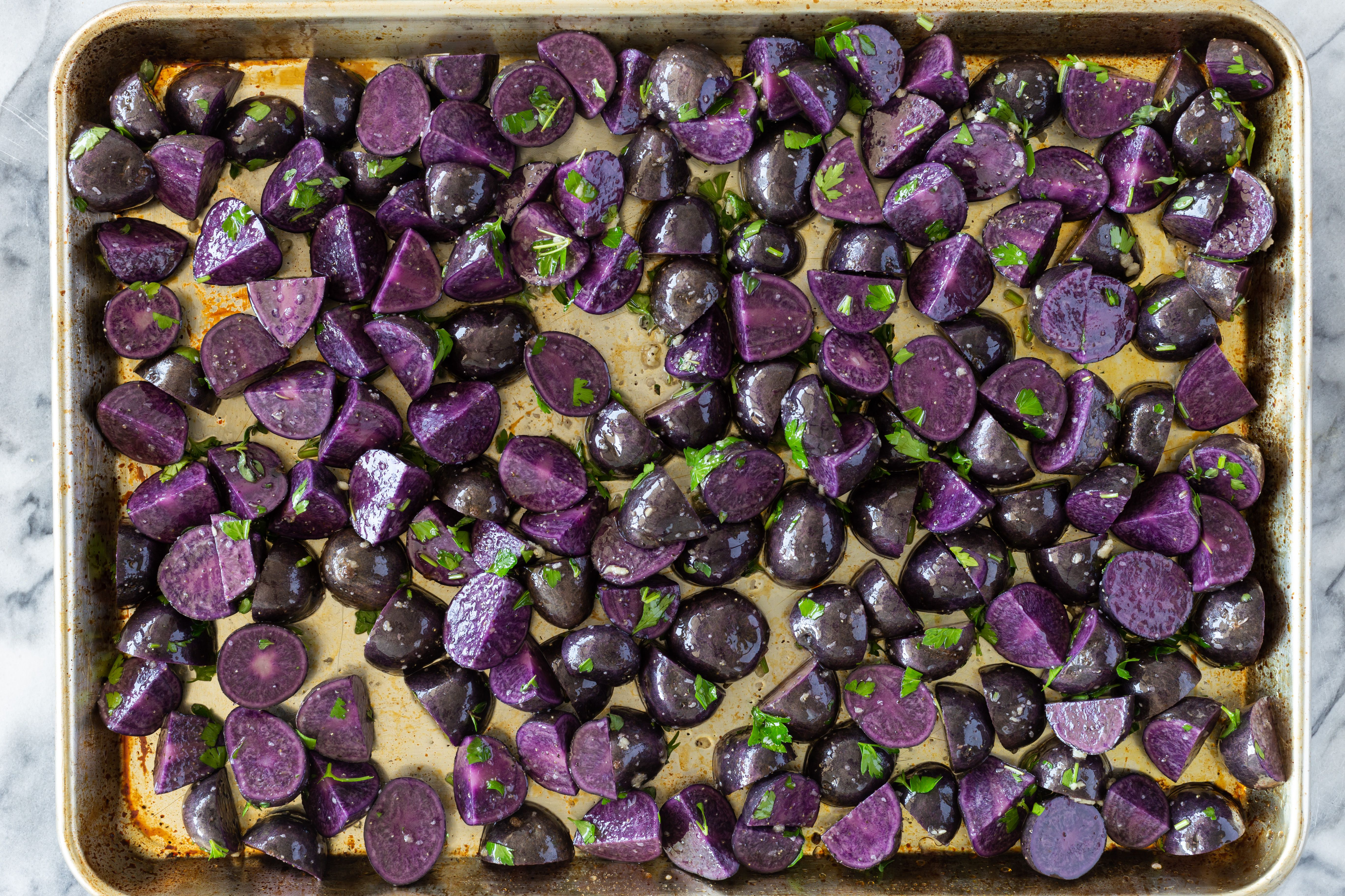 Purple potatoes on baking sheet