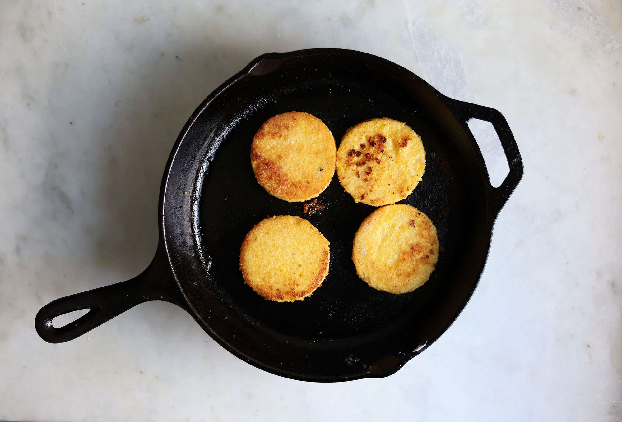 polenta cooked in a cast iron skillet