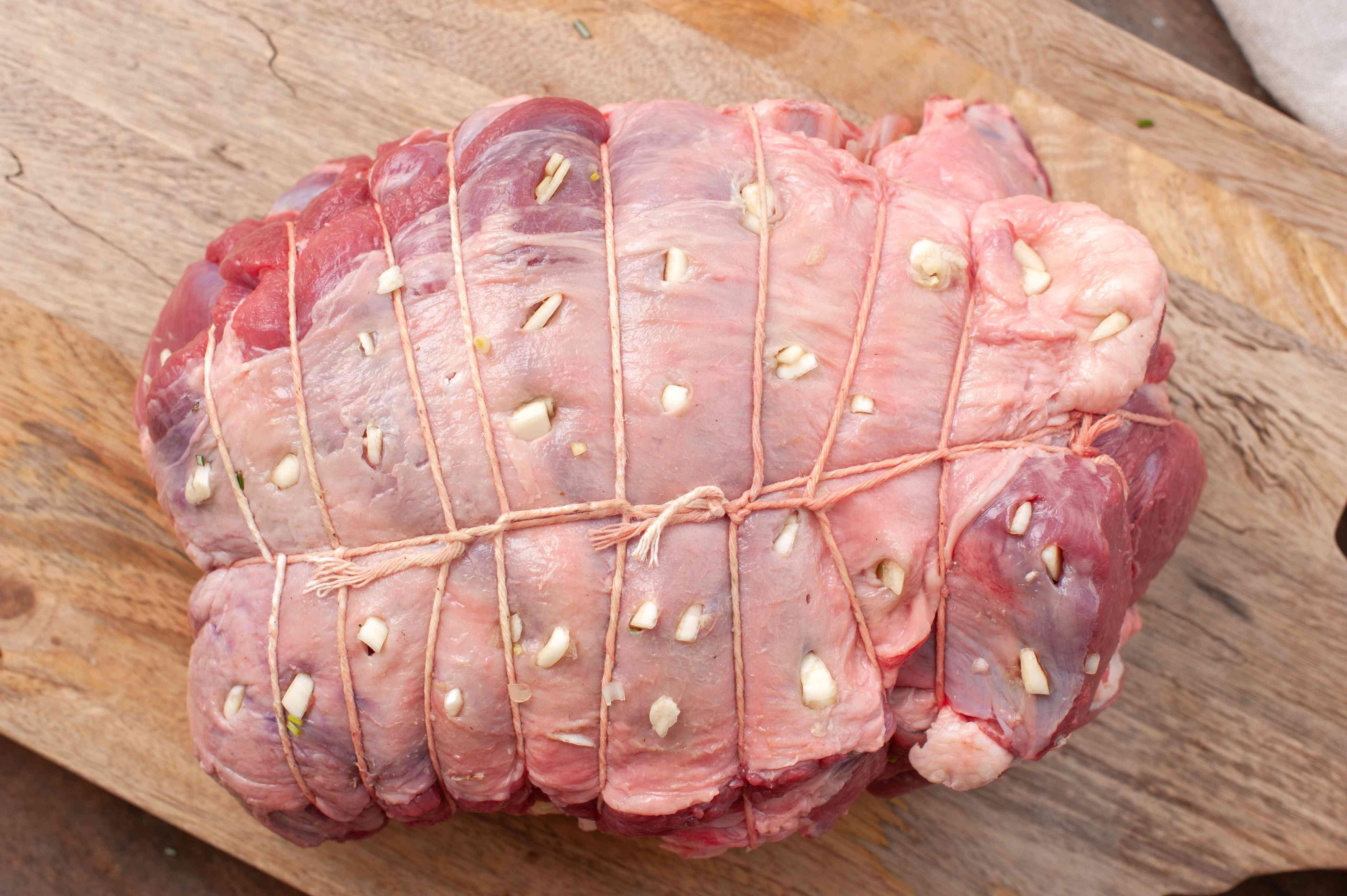 Cut slits in roast