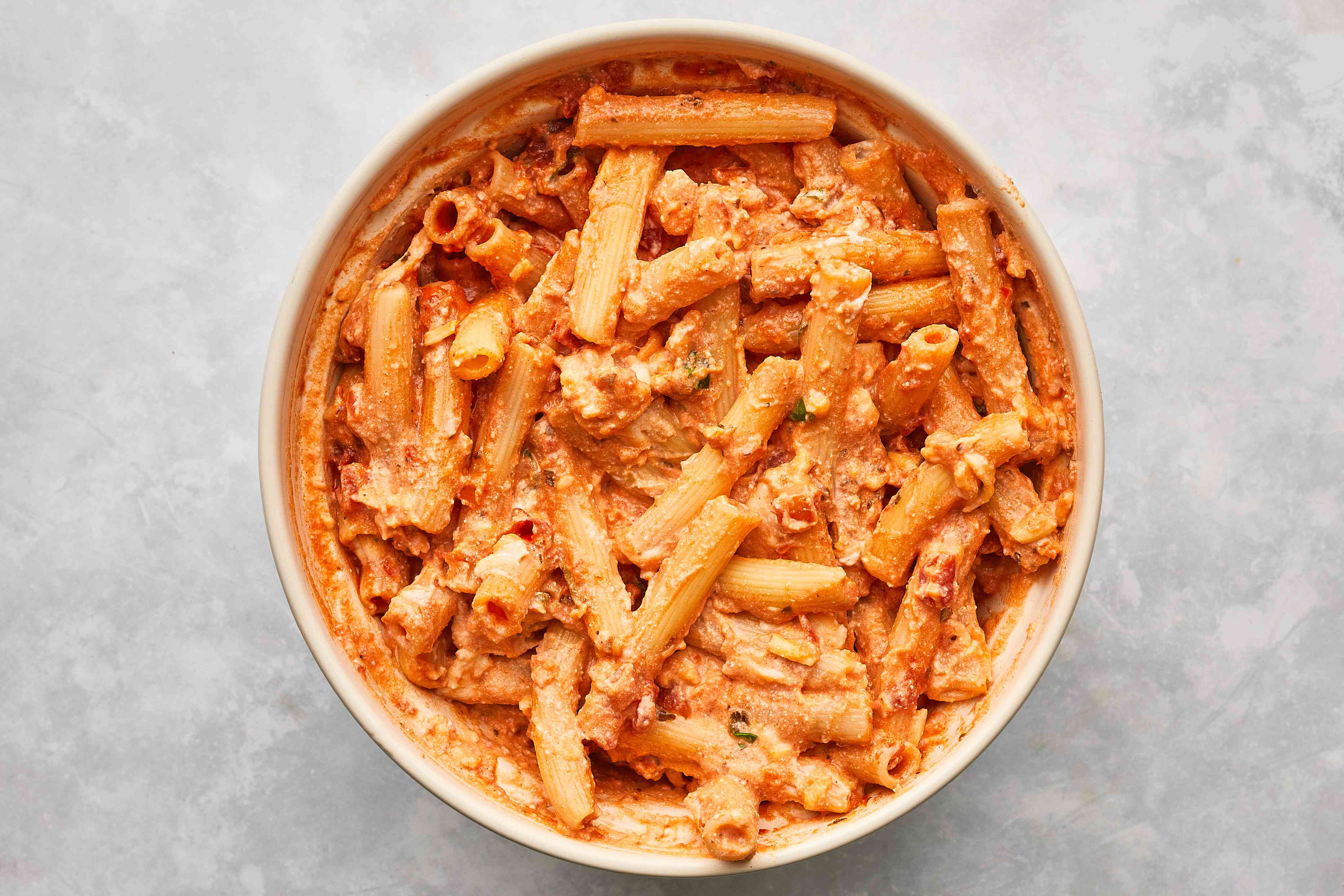 ziti with tomato sauce and ricotta mixture in a bowl