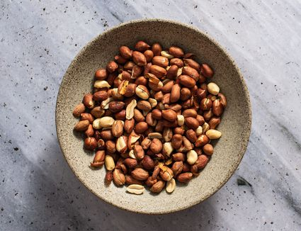 Oven roasted peanuts in a bowl