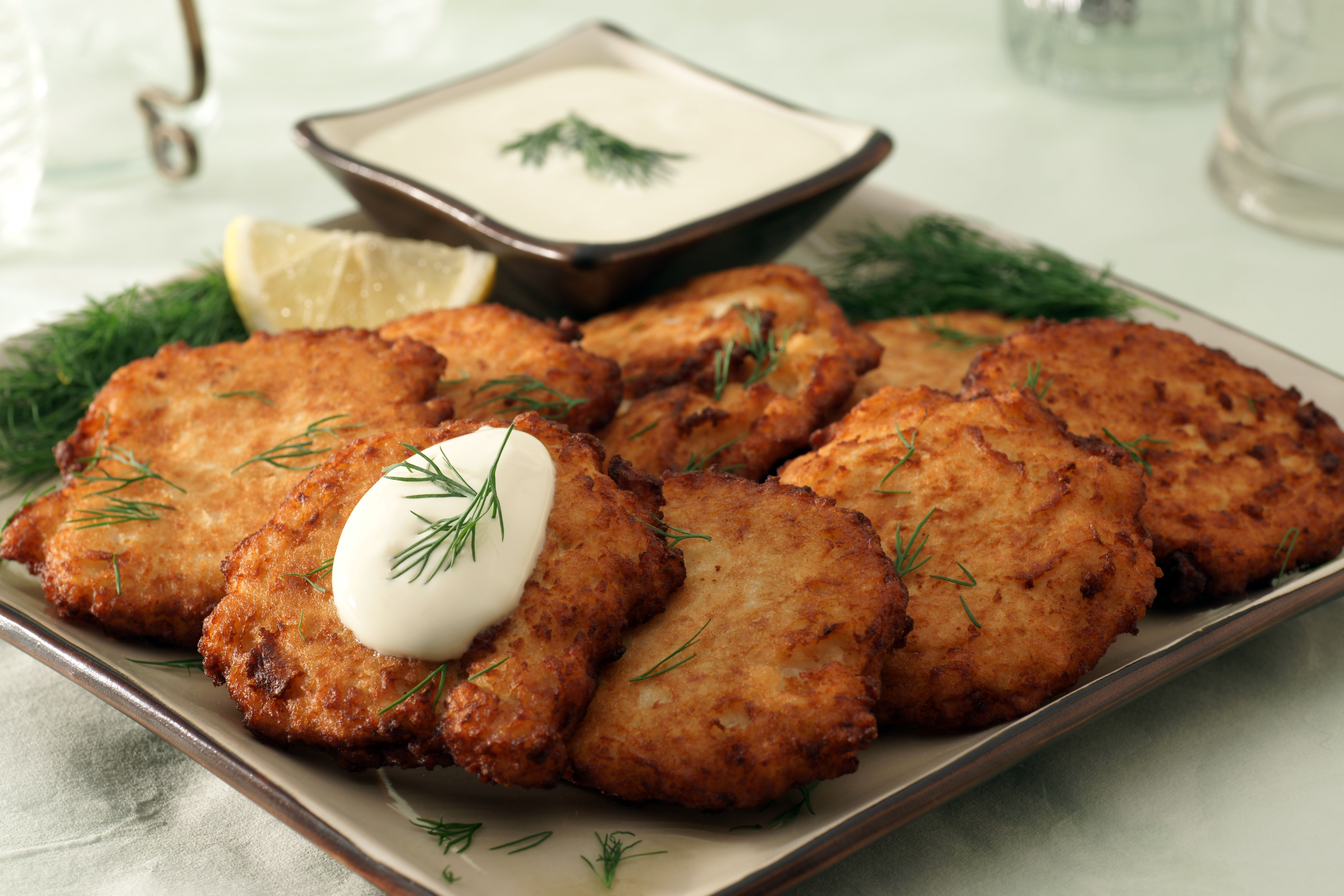 Latkes with garnishes and dressing