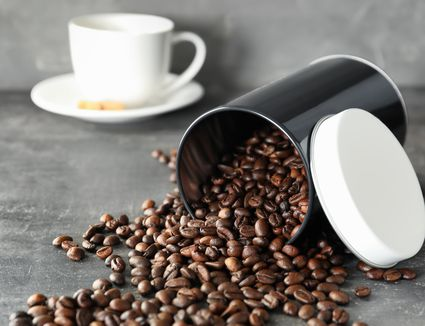 coffee beans spilling out of storage container