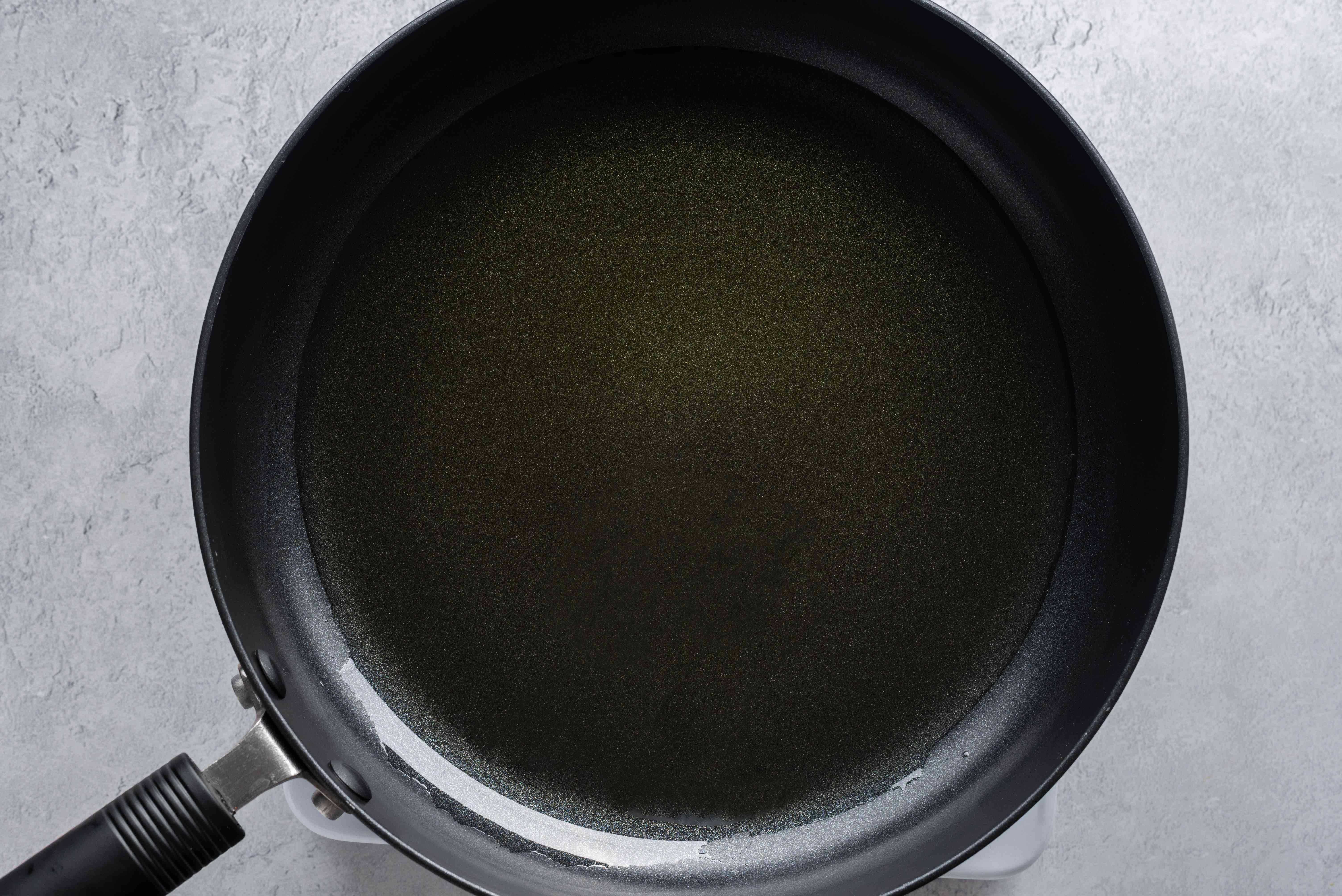 In a large skillet heat 1-inch of olive oil