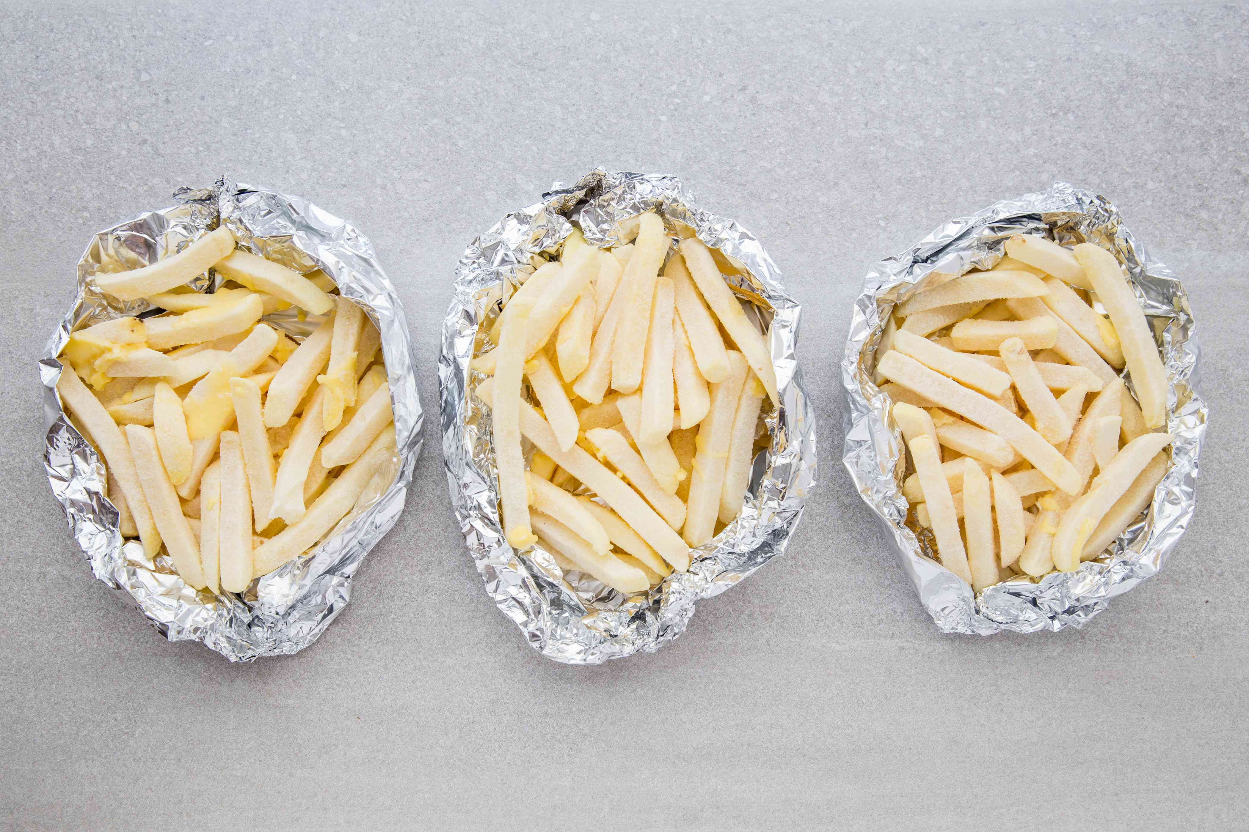 frozen french fries in aluminum foil boats