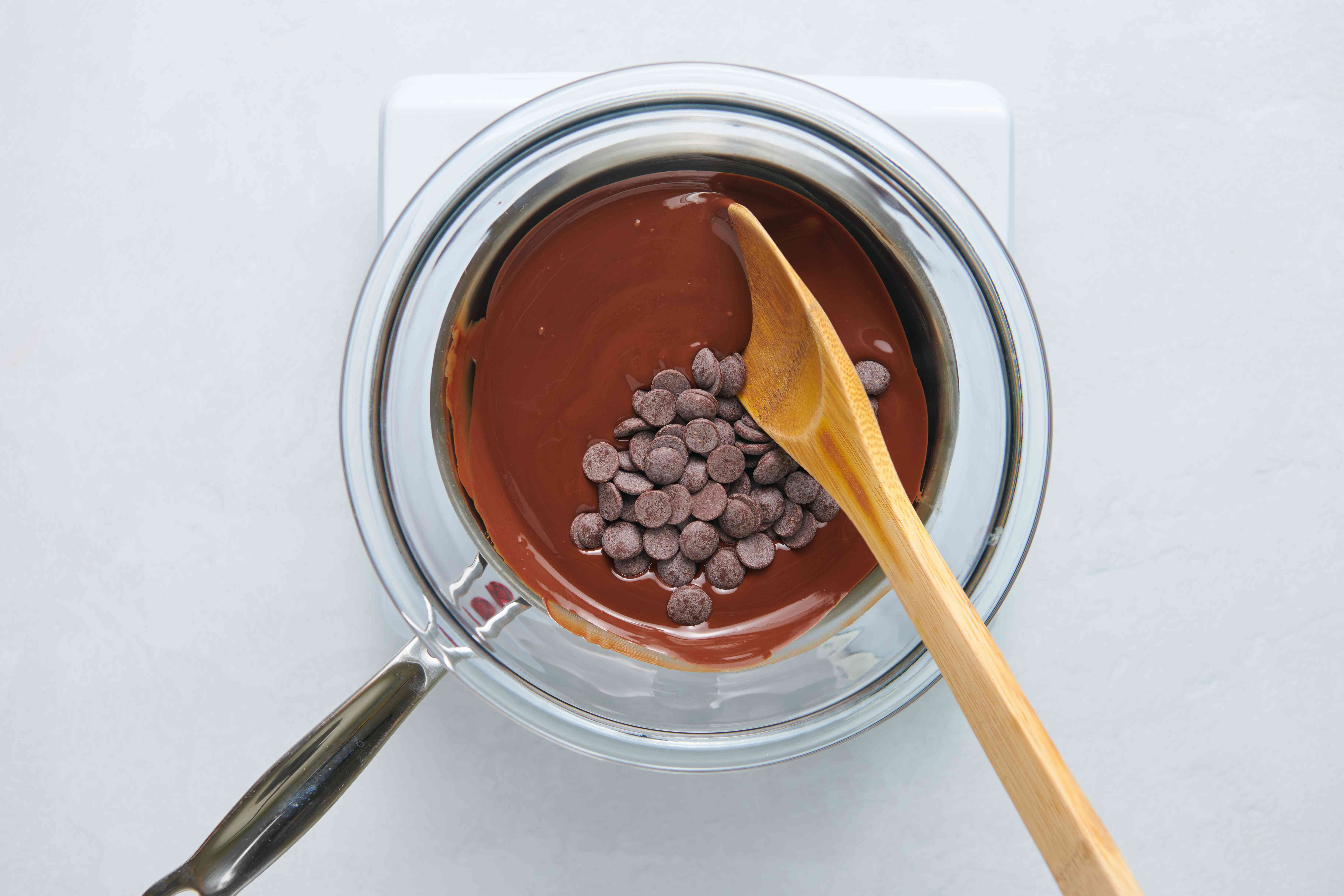 chocolate chips and melted chocolate in a double boiler